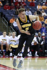 Jordan Bohannon scored 13 points in his NCAA Tournament debut Friday against Cincinnati.