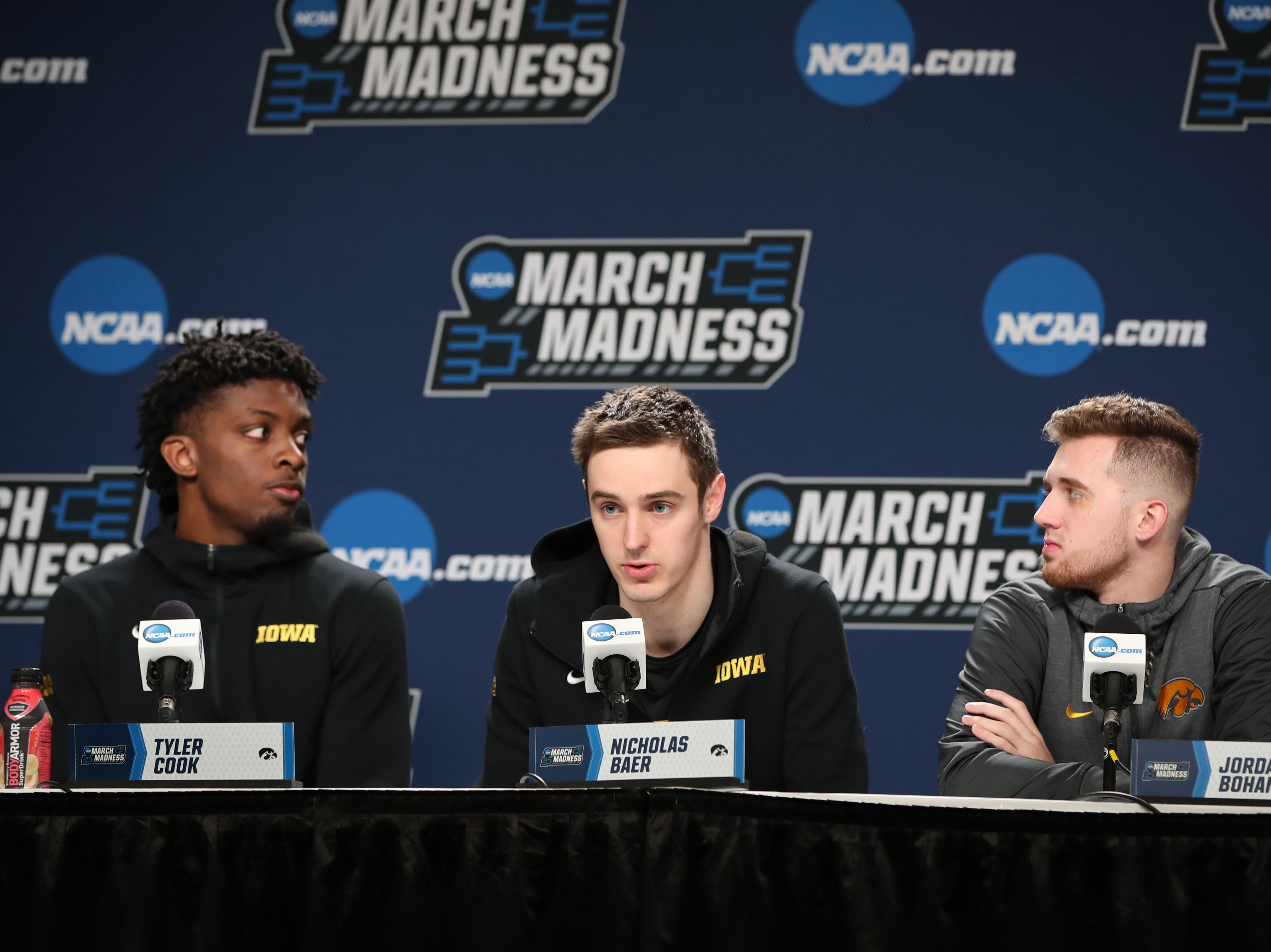 Iowa Hawkeyes forward Tyler Cook (25) forward Nicholas Baer (51) guard Jordan Bohannon (3) speak with the media during practice before the first round of the 2019 NCAA Tournament at Nationwide Arena on March 21, 2019, in Columbus, Ohio.
