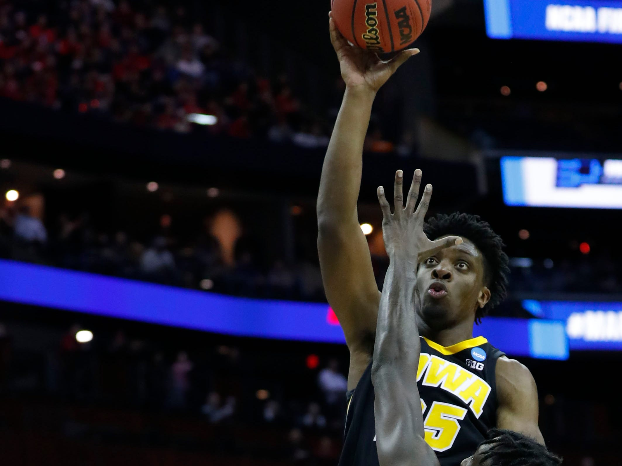 Mar 22, 2019; Columbus, OH, USA; Iowa Hawkeyes forward Tyler Cook (25) shoots the ball defended by Cincinnati Bearcats center Nysier Brooks (33) in the second half in the first round of the 2019 NCAA Tournament at Nationwide Arena. Mandatory Credit: Rick Osentoski-USA TODAY Sports