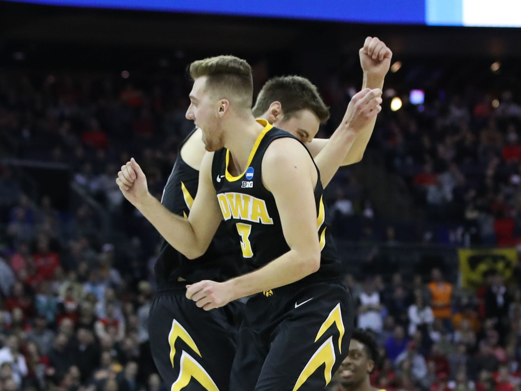 Iowa Hawkeyes guard Jordan Bohannon (3) and forward Nicholas Baer (51) react to defeating Cincinnati Bearcats in the first round of the 2019 NCAA Tournament at Nationwide Arena on March 22, 2019.