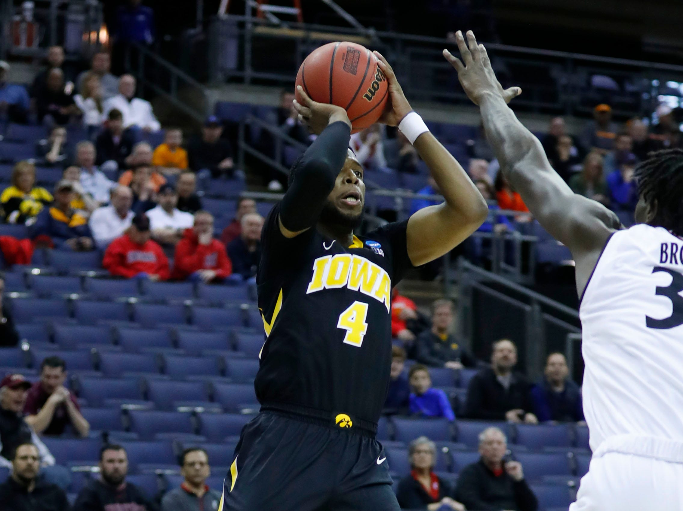 Mar 22, 2019; Columbus, OH, USA; Iowa Hawkeyes guard Isaiah Moss (4) shoots the ball over Cincinnati Bearcats center Nysier Brooks (33) in the first half in the first round of the 2019 NCAA Tournament at Nationwide Arena. Mandatory Credit: Rick Osentoski-USA TODAY Sports