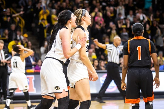 Iowa center Megan Gustafson (10) embraces teammate Hannah Stewart (21) after a NCAA women's basketball tournament first-round game against Mercer, Friday, March 22, 2019, at Carver-Hawkeye Arena in Iowa City, Iowa.