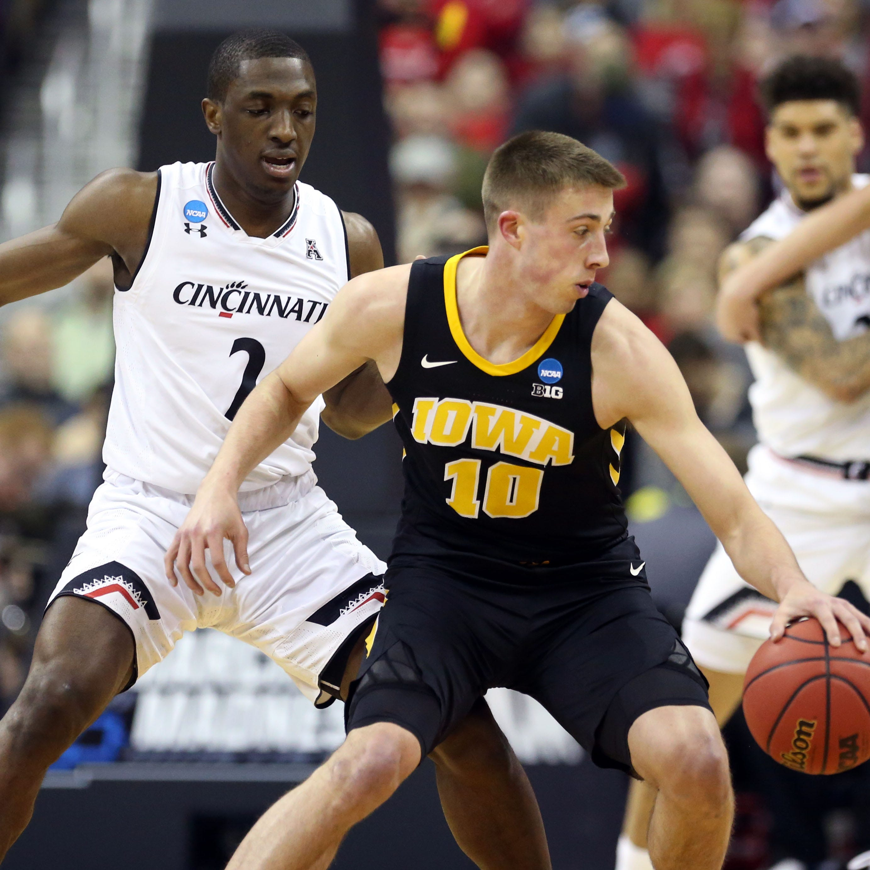 Hawkeyes storm back from early hole to thump Cincinnati in NCAA Tournament opener