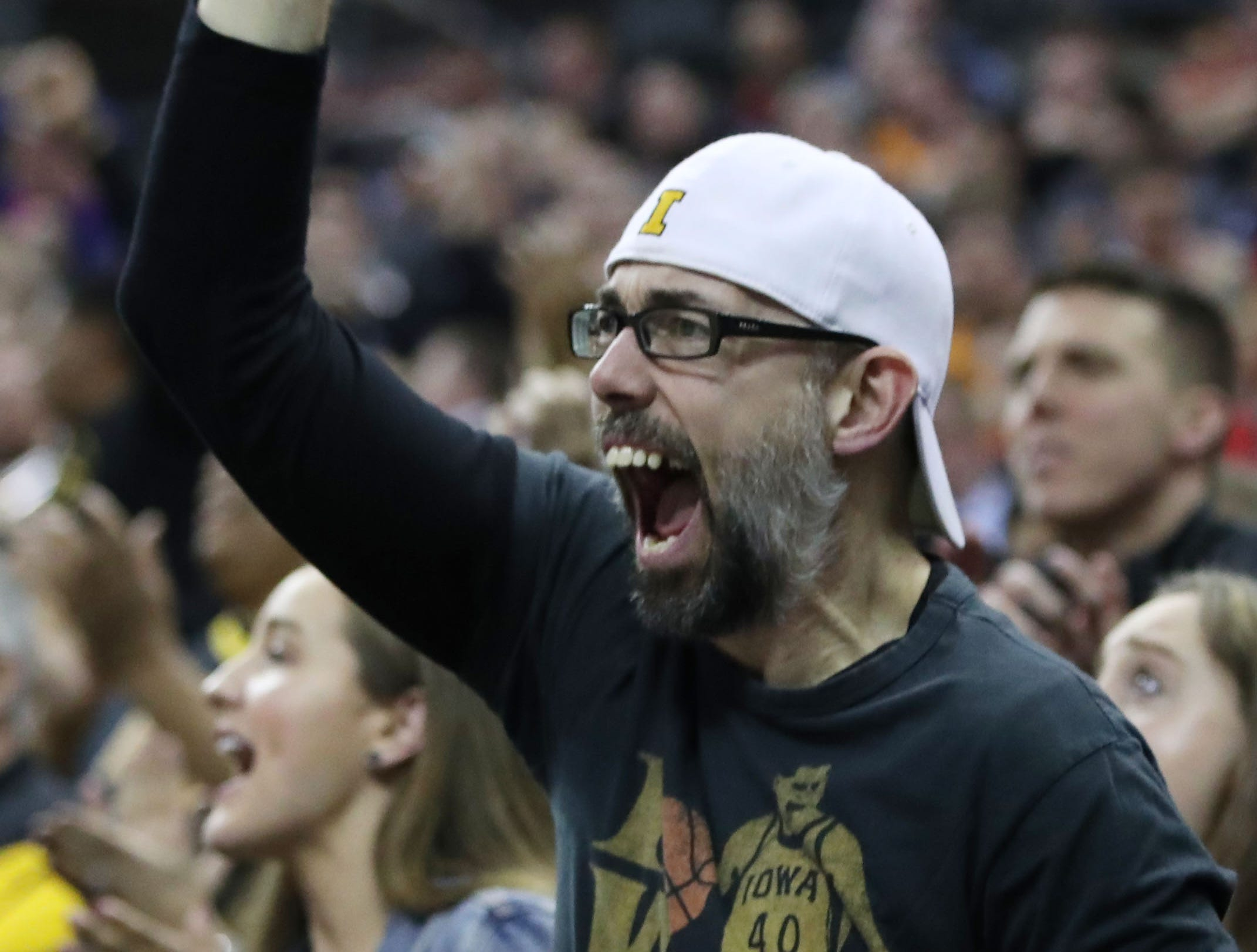 A Hawkeyes fan reacts to play in the second half against the Cincinnati Bearcats in the first round of the 2019 NCAA Tournament at Nationwide Arena on March 22, 2019.