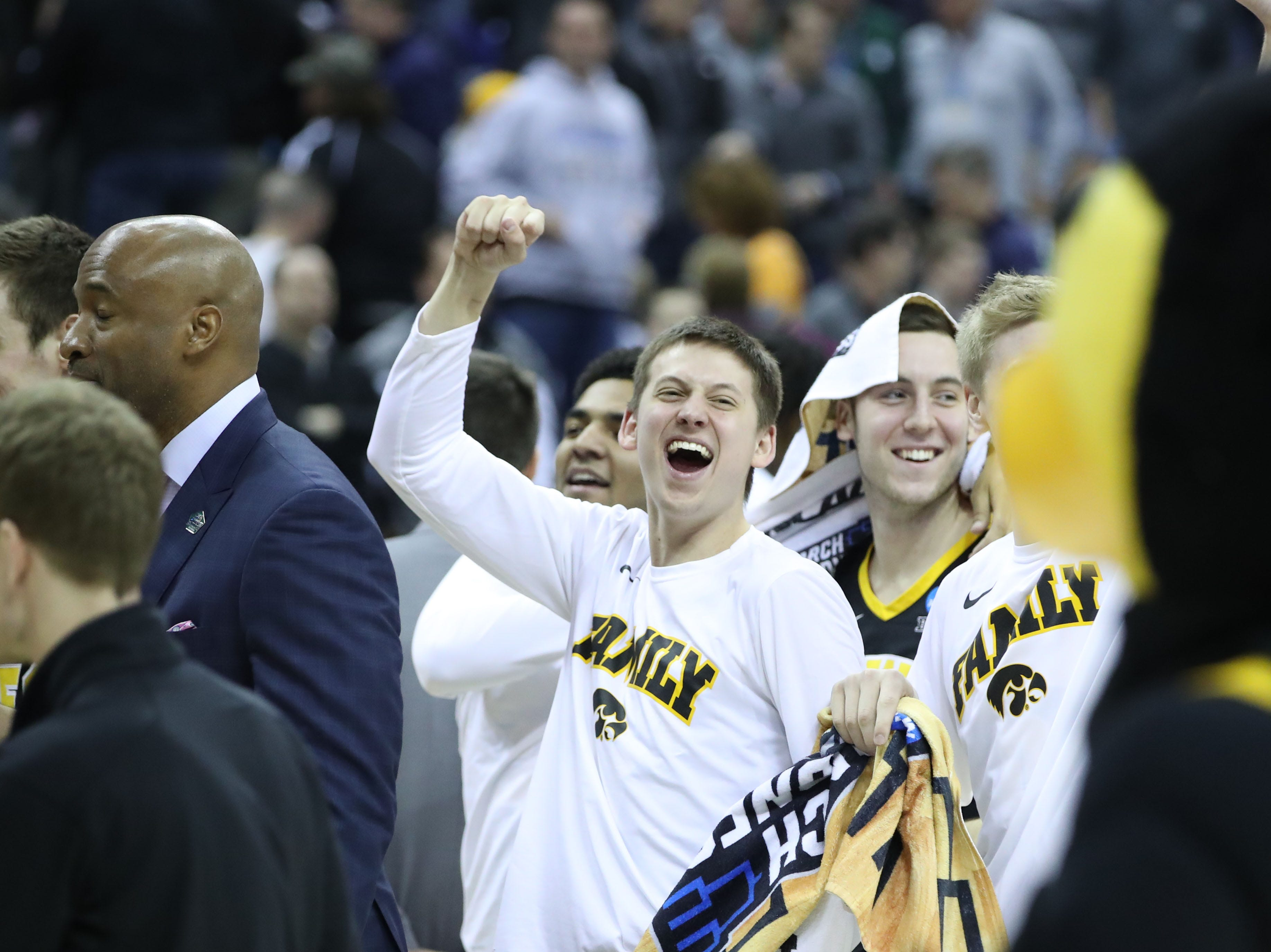 Iowa Hawkeyes bench reacts to defeating Cincinnati Bearcats in the first round of the 2019 NCAA Tournament at Nationwide Arena on March 22, 2019.