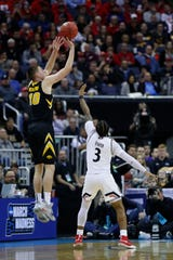 Mar 22, 2019; Columbus, OH, USA; Iowa Hawkeyes guard Joe Wieskamp (10) shoots the ball over Cincinnati Bearcats guard Justin Jenifer (3) in the second half in the first round of the 2019 NCAA Tournament at Nationwide Arena. Mandatory Credit: Rick Osentoski-USA TODAY Sports
