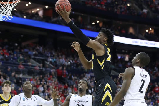 Iowa forward Tyler Cook goes to the basket against Cincinnati on Friday. The Hawkeyes' leading scorer made only 1 of 9 shots, but his team won 79-72, so he could smile afterward. Iowa faces Tennessee on Sunday.