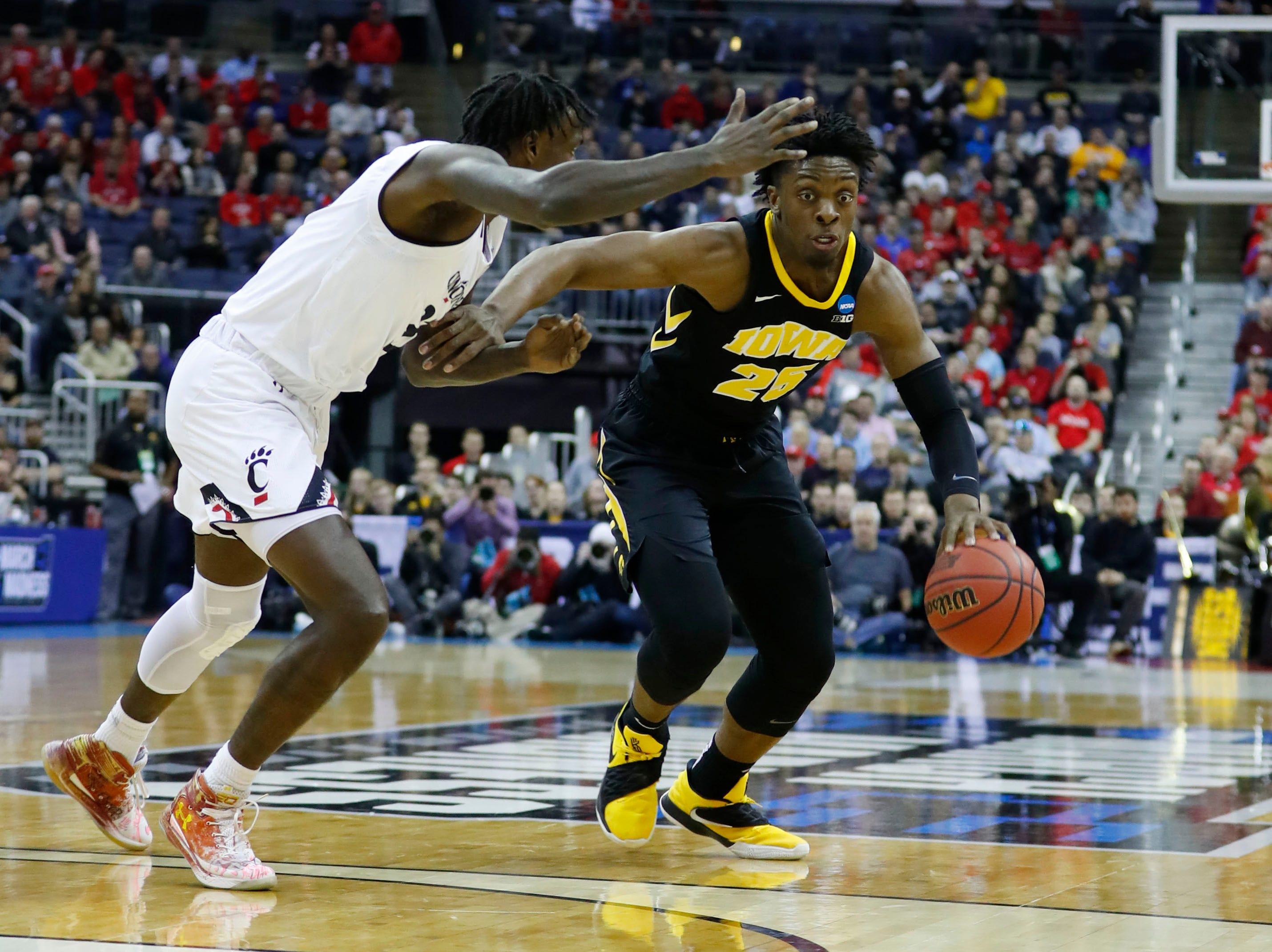Mar 22, 2019; Columbus, OH, USA; Iowa Hawkeyes forward Tyler Cook (25) drives down the court defended by Cincinnati Bearcats center Nysier Brooks (33) in the first round of the 2019 NCAA Tournament at Nationwide Arena. Mandatory Credit: Rick Osentoski-USA TODAY Sports