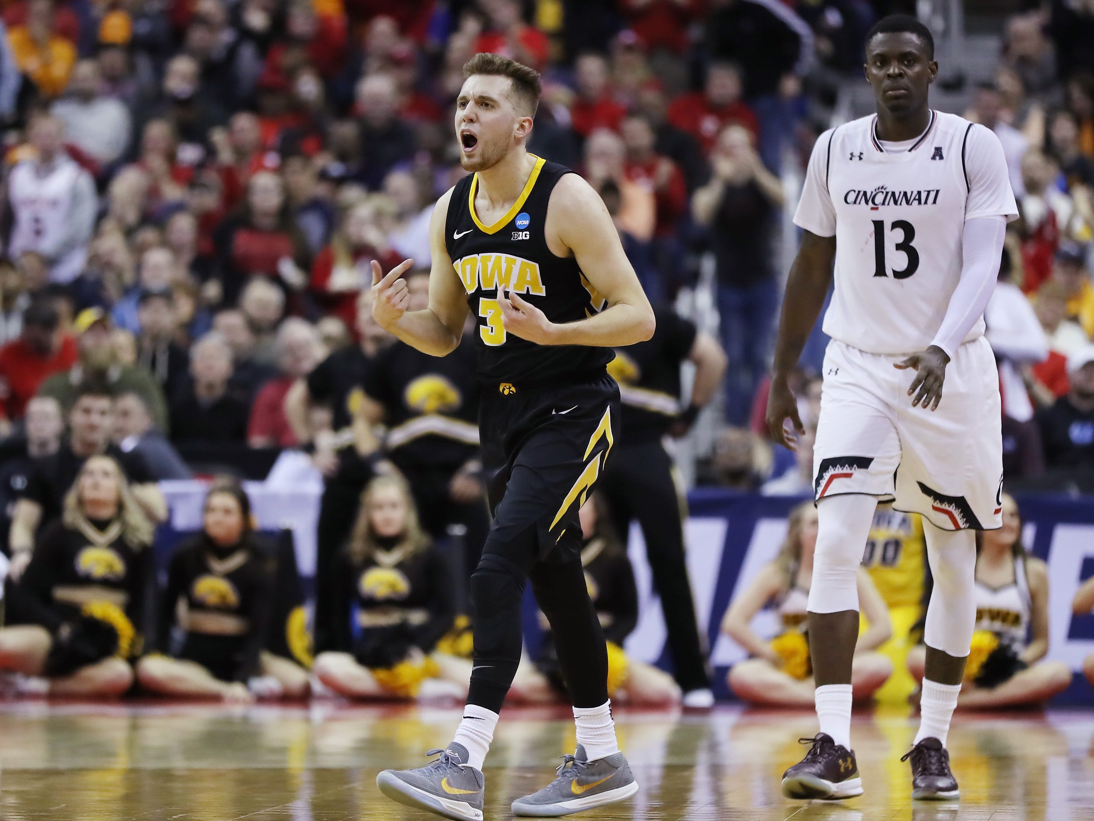 Jordan Bohannon celebrates late during Iowa's 79-72 win against Cincinnati, in which he scored all 13 of his points in the final 20:01.