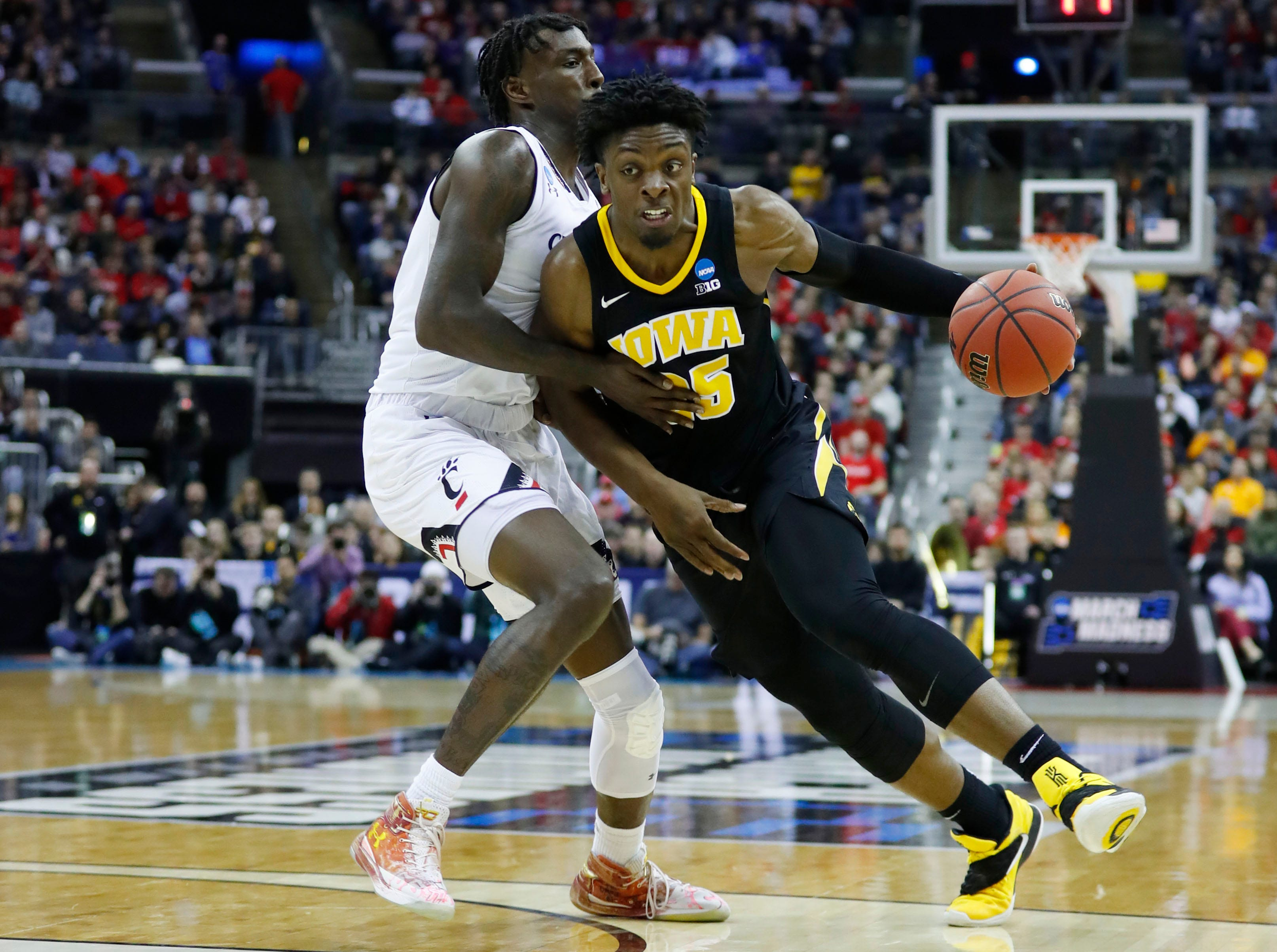 Mar 22, 2019; Columbus, OH, USA; Iowa Hawkeyes forward Tyler Cook (25) drives down the court defended by Cincinnati Bearcats center Nysier Brooks (33) in the first half in the first round of the 2019 NCAA Tournament at Nationwide Arena. Mandatory Credit: Rick Osentoski-USA TODAY Sports