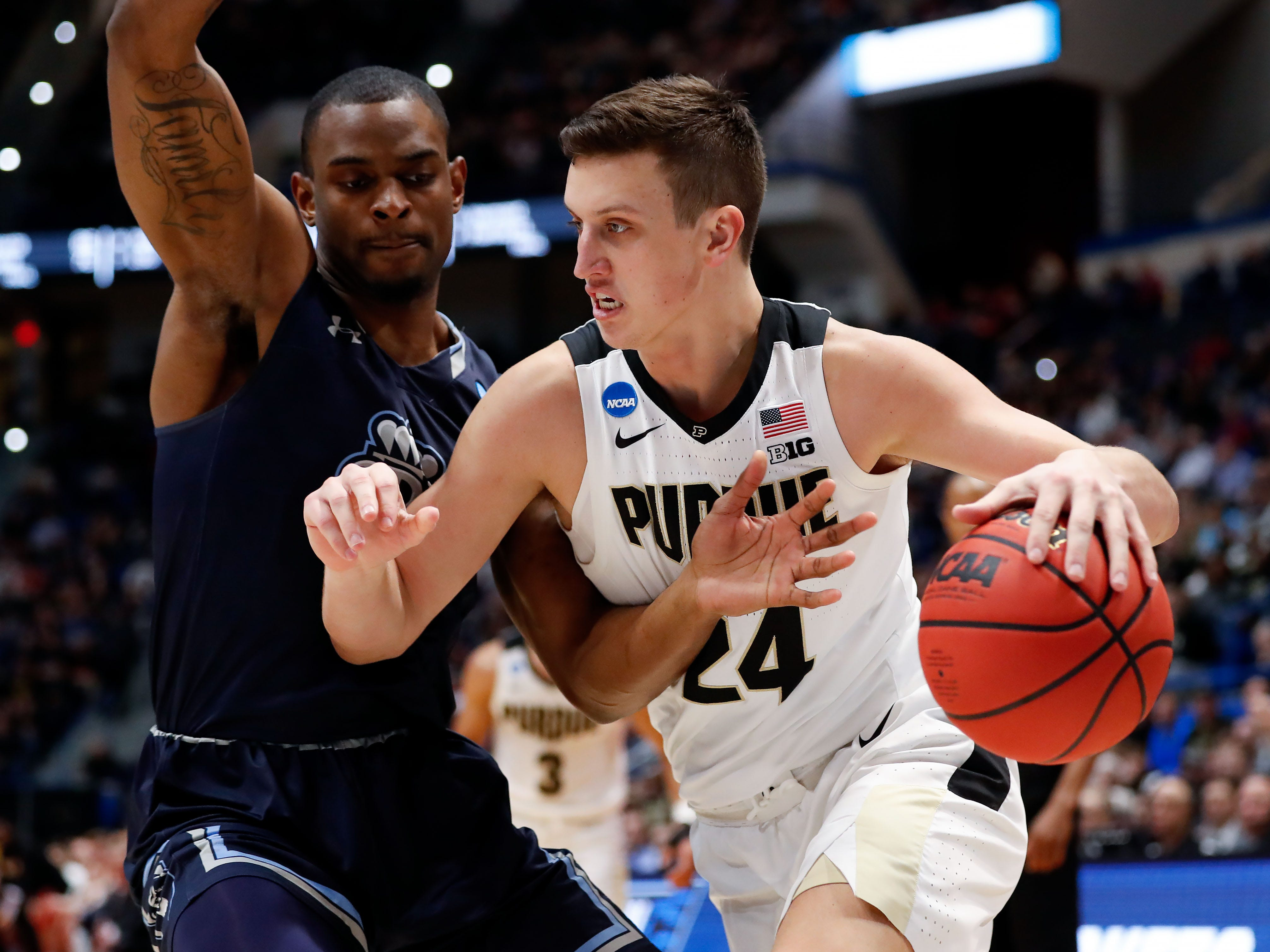 Purdue Boilermakers forward Grady Eifert (24) drives against Old Dominion Monarchs forward Aaron Carver (13) during the first half of a game in the first round of the 2019 NCAA Tournament at XL Center.