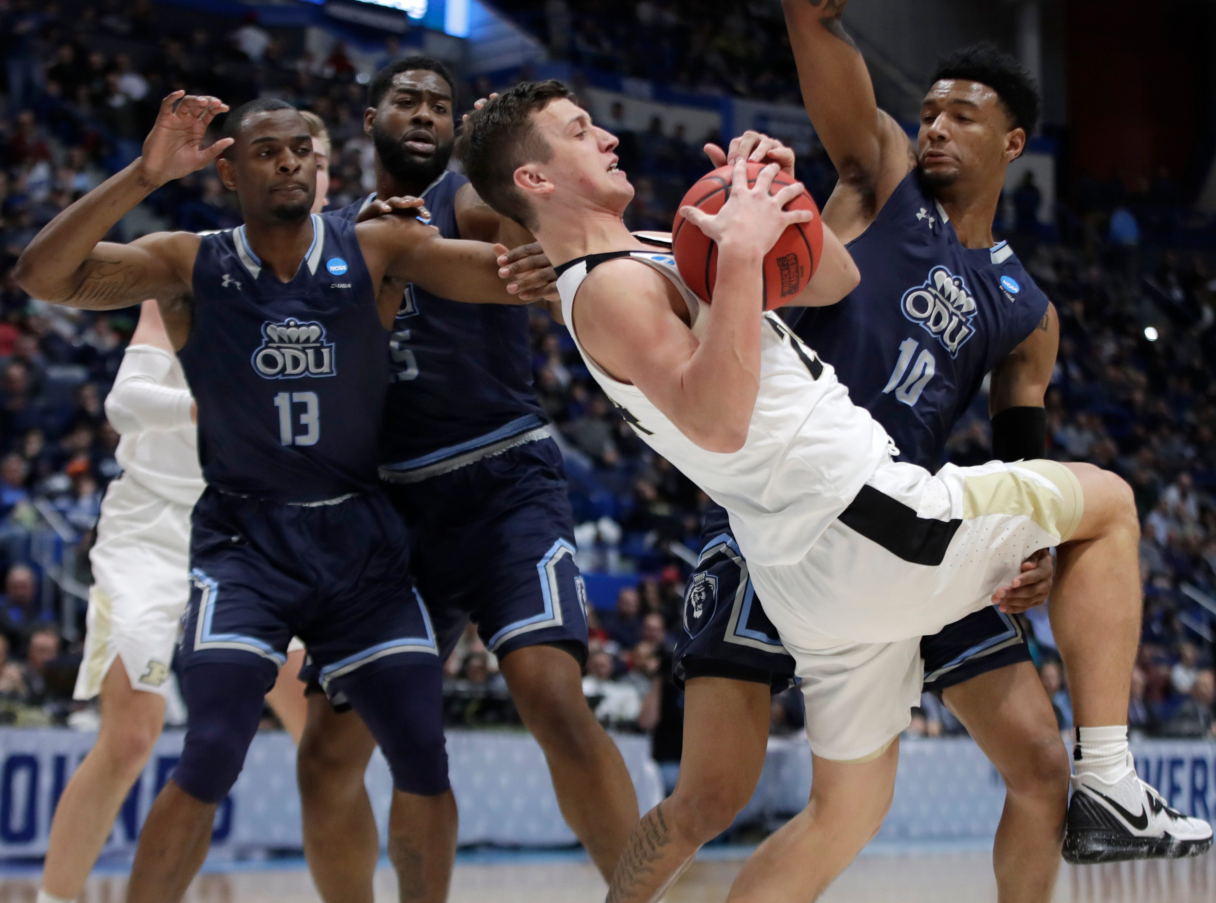 Purdue's Grady Eifert (24) pulls down and controls a rebound against Old Dominion's Aaron Carver (13), Joseph Reece (15) and Xavier Green (10) during the first half of a first round men's college basketball game in the NCAA Tournament, Thursday, March 21, 2019, in Hartford, Conn.