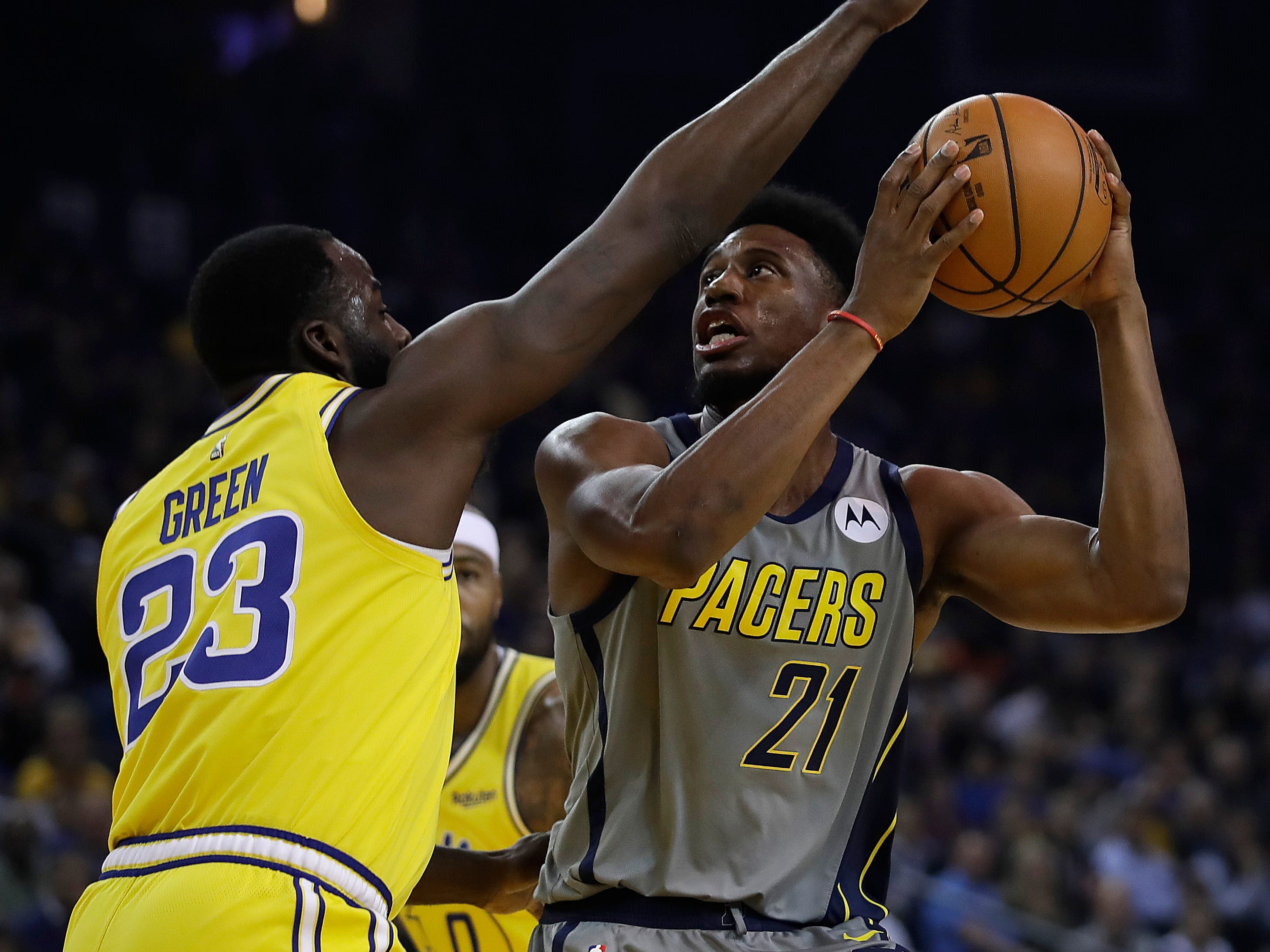 Indiana Pacers' Thaddeus Young, right, shoots against Golden State Warriors' Draymond Green (23) during the first half of an NBA basketball game Thursday, March 21, 2019, in Oakland, Calif.