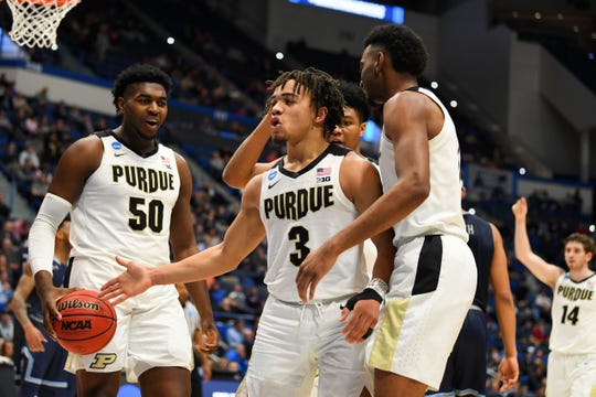 Purdue Boilermakers forward Trevion Williams (50), guard Carsen Edwards (3), and forward Aaron Wheeler (1) react during a timeout during the second half of a game against the Old Dominion Monarchs in the first round of the 2019 NCAA Tournament at XL Center.