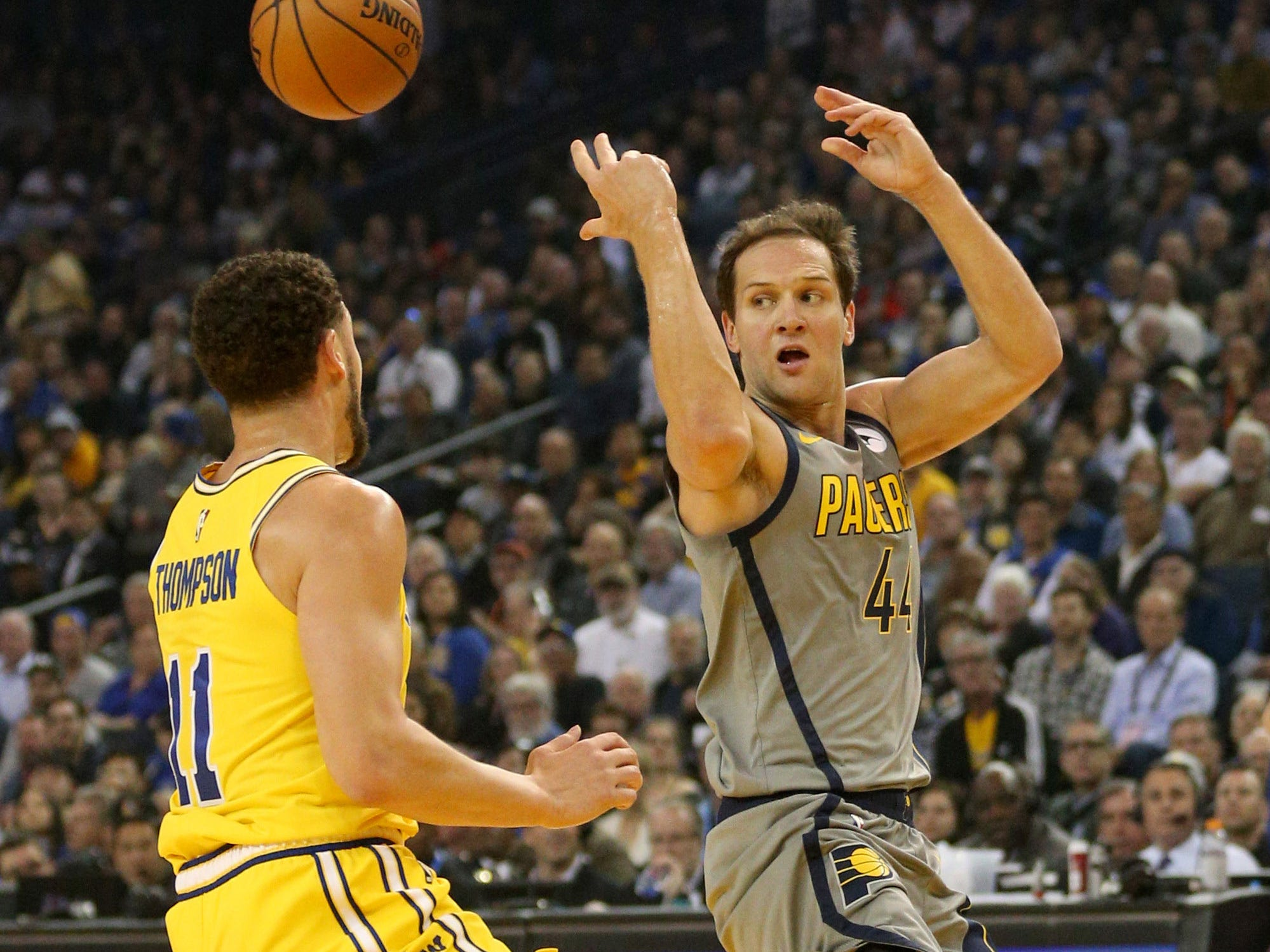 Mar 21, 2019; Oakland, CA, USA; Indiana Pacers forward Bojan Bogdanovic (44) throws a pass away from the reach of Golden State Warriors guard Klay Thompson (11) in the first quarter at Oracle Arena.