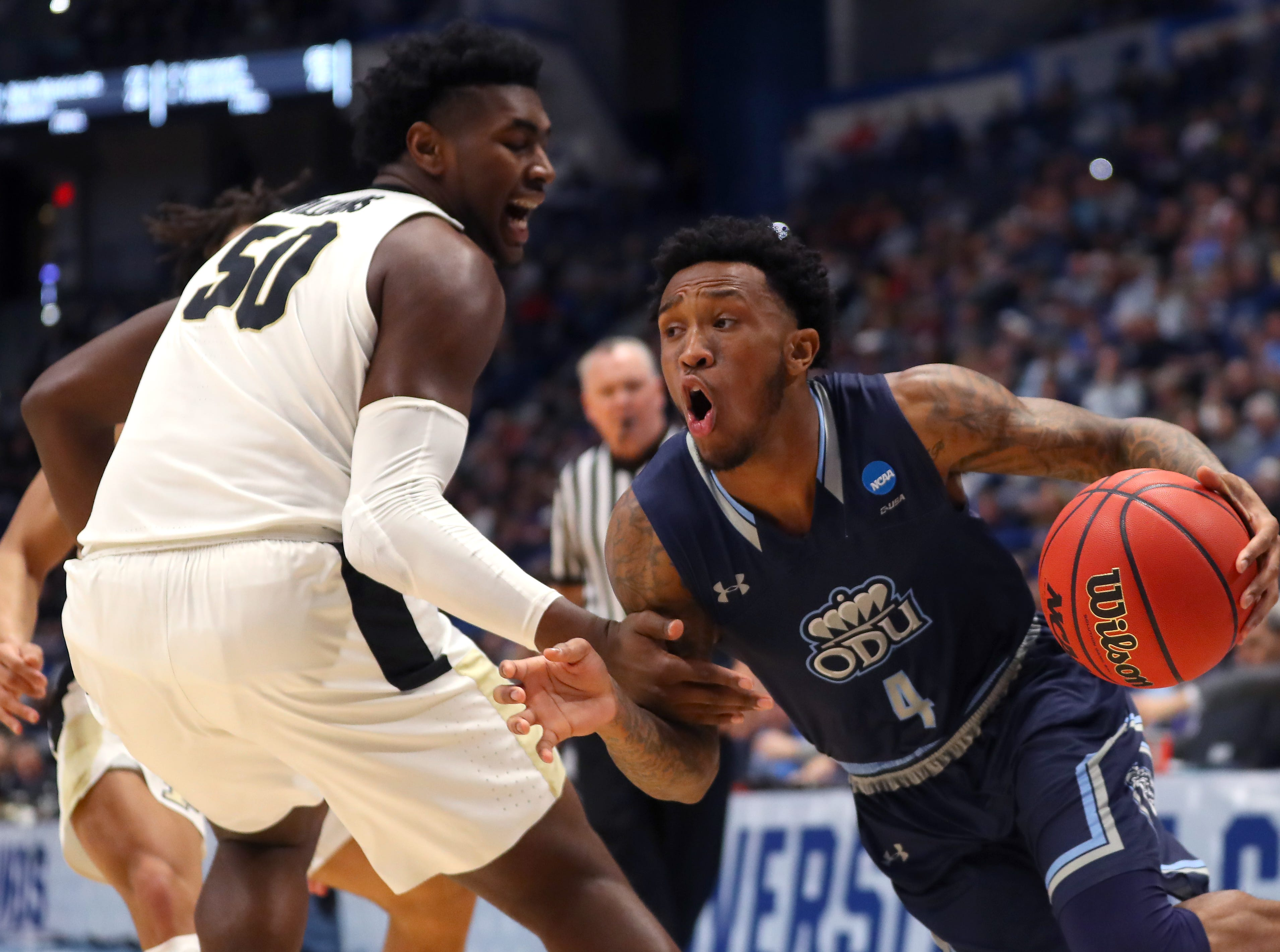 Ahmad Caver #4 of the Old Dominion Monarchs drives with the ball against Trevion Williams #50 of the Purdue Boilermakers in the first half during the first round of the 2019 NCAA Men's Basketball Tournament at XL Center on March 21, 2019 in Hartford, Connecticut.