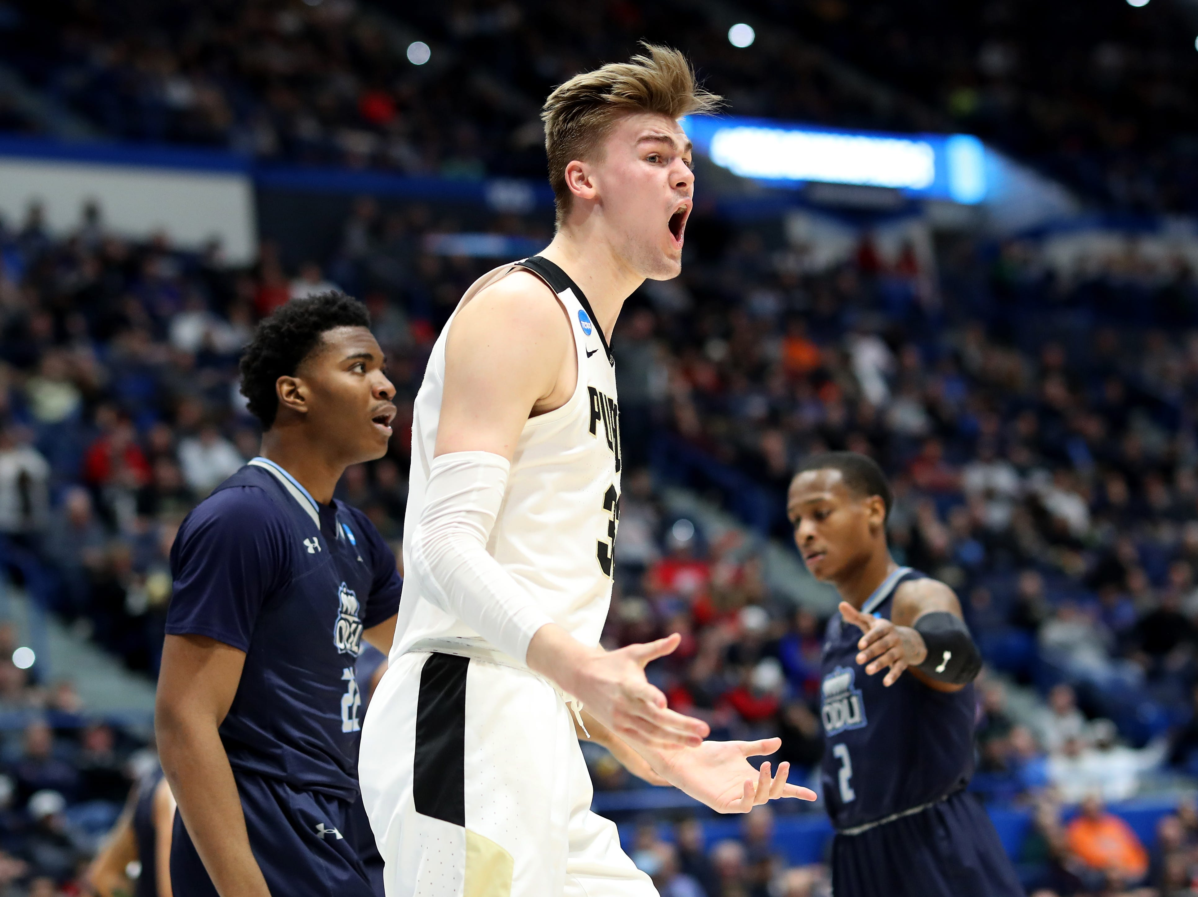 Matt Haarms #32 of the Purdue Boilermakers reacts after a play in the first half against the Old Dominion Monarchs during the 2019 NCAA Men's Basketball Tournament at XL Center on March 21, 2019 in Hartford, Connecticut.