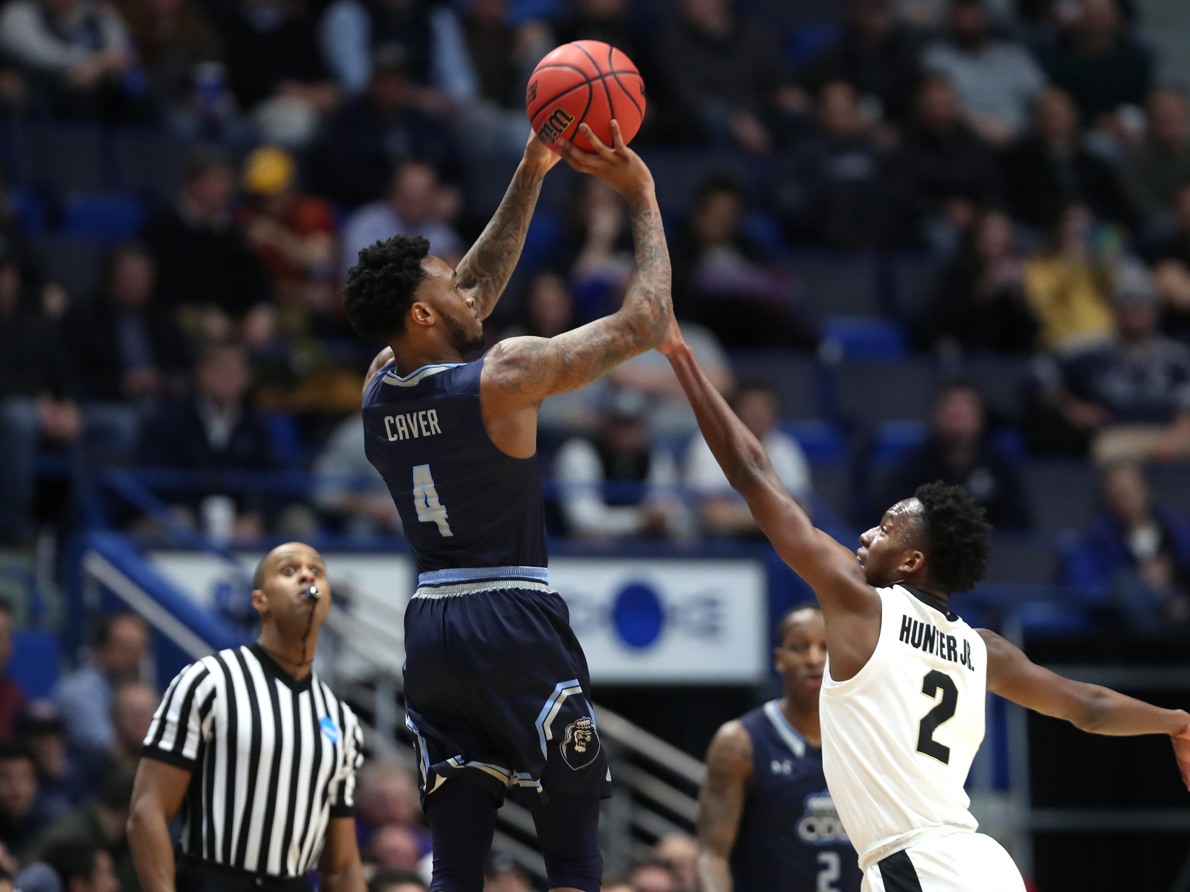 Ahmad Caver #4 of the Old Dominion Monarchs shoots against Eric Hunter Jr. #2 of the Purdue Boilermakers in the first half during the 2019 NCAA Men's Basketball Tournament at XL Center on March 21, 2019 in Hartford, Connecticut.