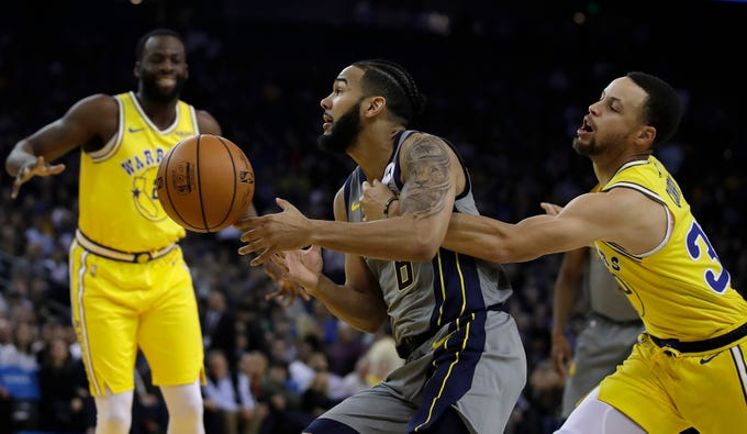 Golden State Warriors' Stephen Curry, right, knocks the ball loose from Indiana Pacers' Cory Joseph (6) during the first half of an NBA basketball game Thursday, March 21, 2019, in Oakland, Calif.