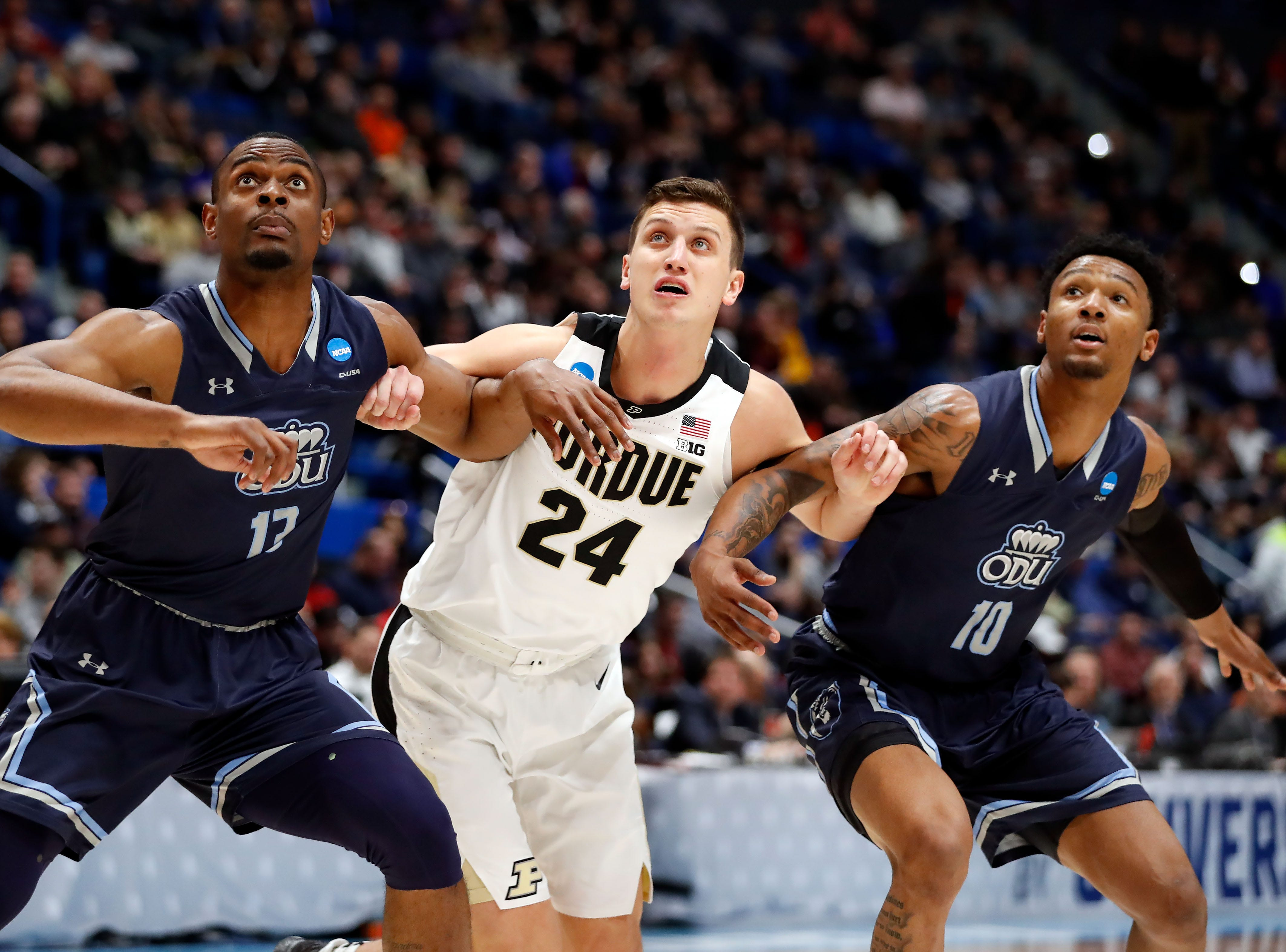 Boilermakers forward Grady Eifert (24) watches a free throw in between Old Dominion Monarchs guard Xavier Green (10) and forward Aaron Carver (13) during the first half of a game in the first round of the 2019 NCAA Tournament at XL Center.