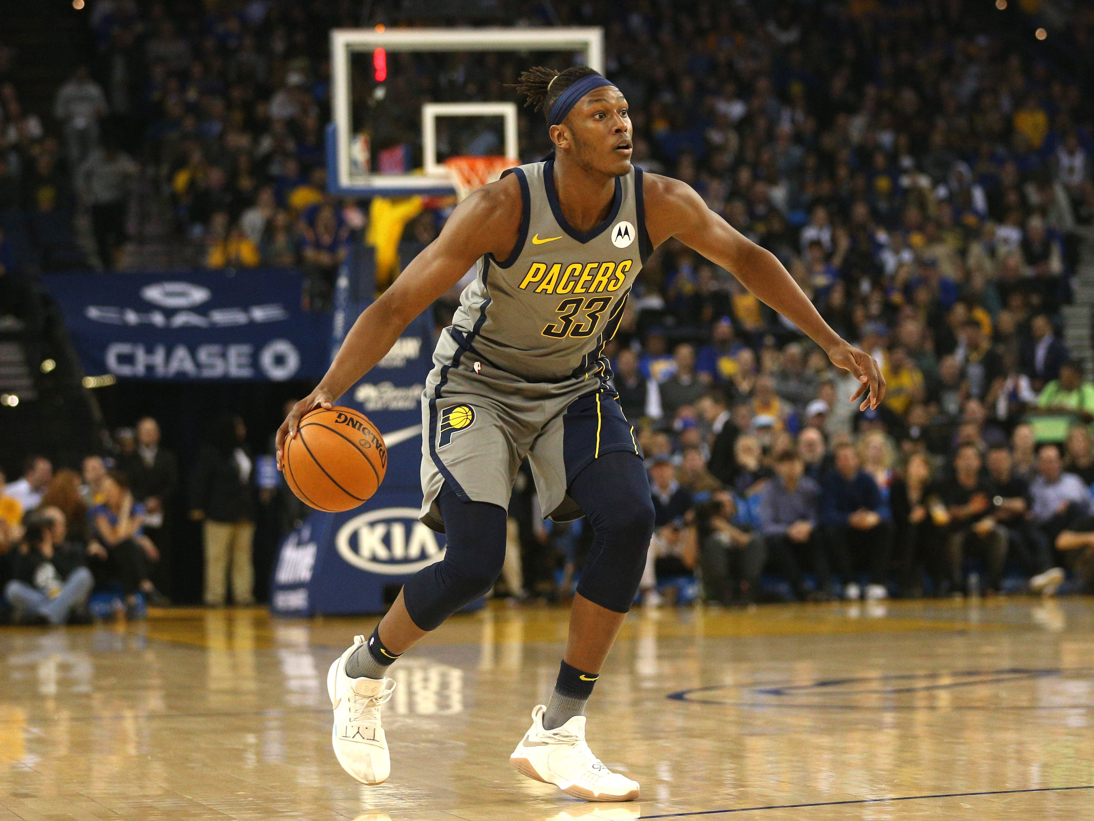 Mar 21, 2019; Oakland, CA, USA; Indiana Pacers center Myles Turner (33) dribbles the ball against the Golden State Warriors in the first quarter at Oracle Arena.