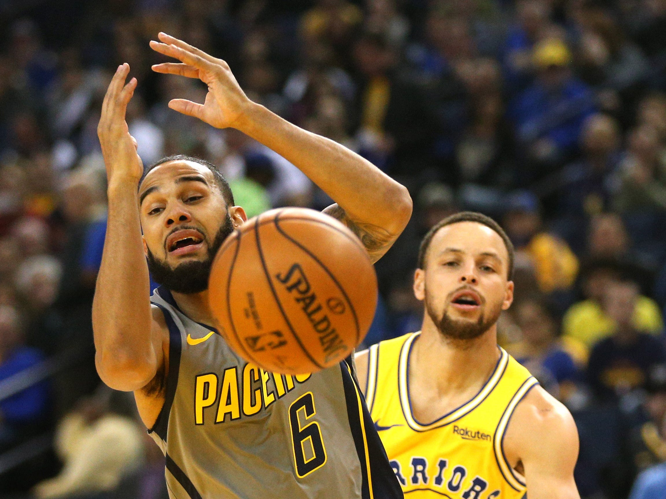 Mar 21, 2019; Oakland, CA, USA; Indiana Pacers guard Cory Joseph (6) loses control of the ball next to Golden State Warriors guard Stephen Curry (30) in the first quarter at Oracle Arena.