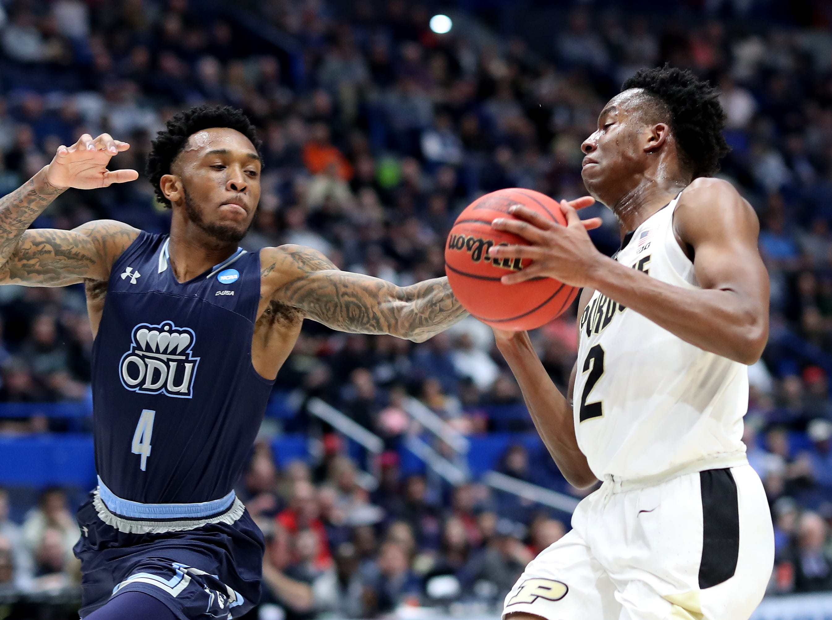 Eric Hunter Jr. #2 of the Purdue Boilermakers handles the ball against Ahmad Caver #4 of the Old Dominion Monarchs in the first half during the 2019 NCAA Men's Basketball Tournament at XL Center on March 21, 2019 in Hartford, Connecticut.