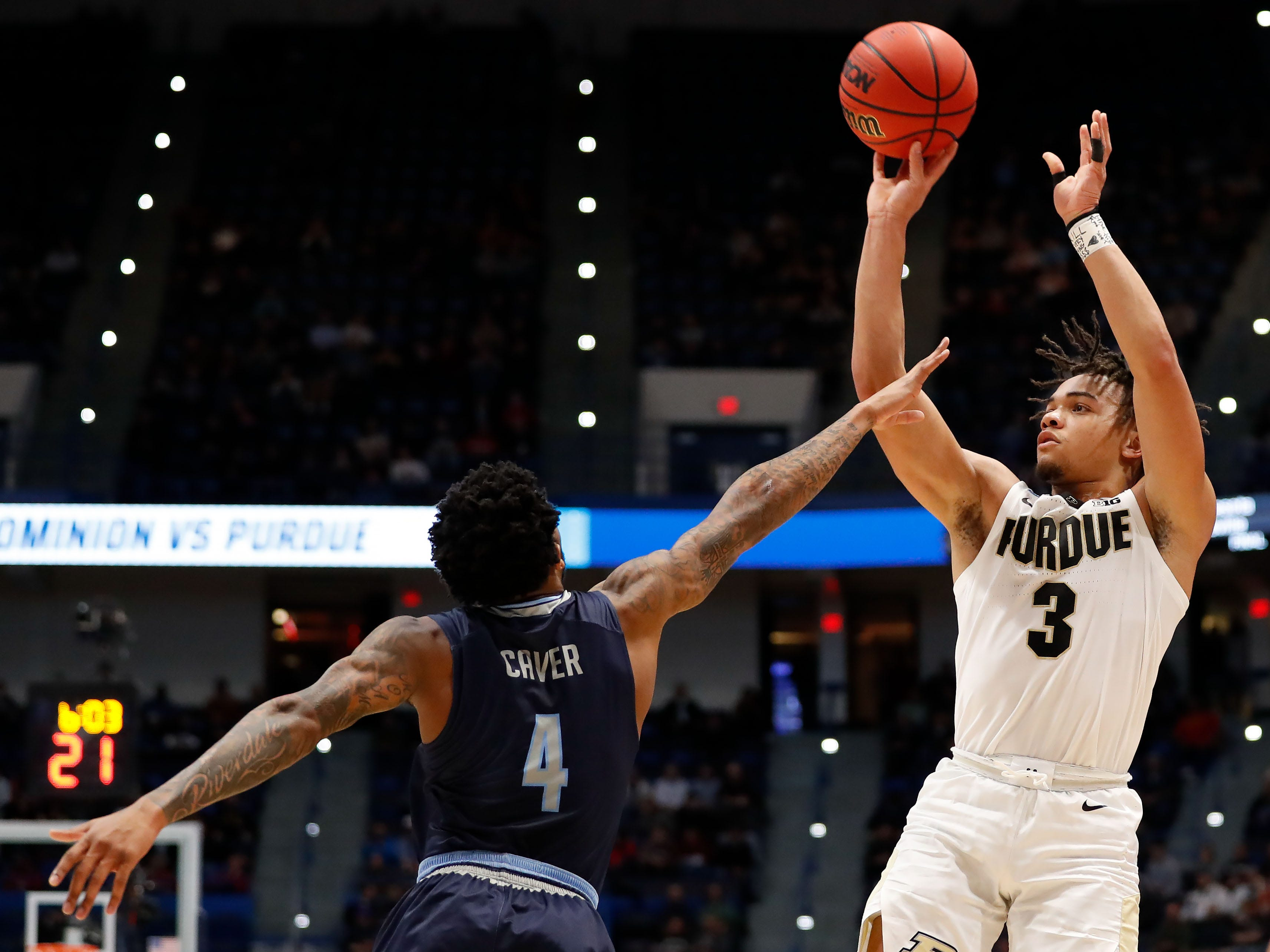 Purdue Boilermakers guard Carsen Edwards (3) attempts a shot over Old Dominion Monarchs guard Ahmad Caver (4) during the first half of a game in the first round of the 2019 NCAA Tournament at XL Center.