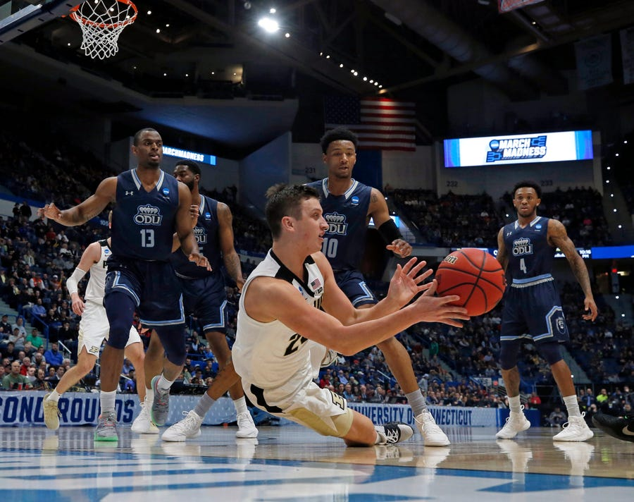 Purdue's Grady Eifert (24) dives to control a rebound against Old Dominion's Aaron Carver (13), Xavier Green (10) and Ahmad Caver (4) during the first half of a first round men's college basketball game in the NCAA Tournament, Thursday, March 21, 2019, in Hartford, Conn.