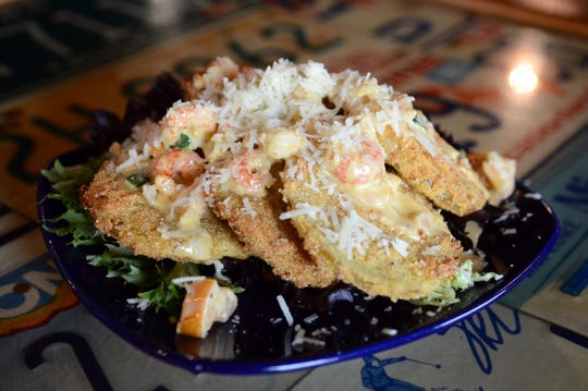 In this file photo, a fried green tomato appetizer at Georgia Blue.