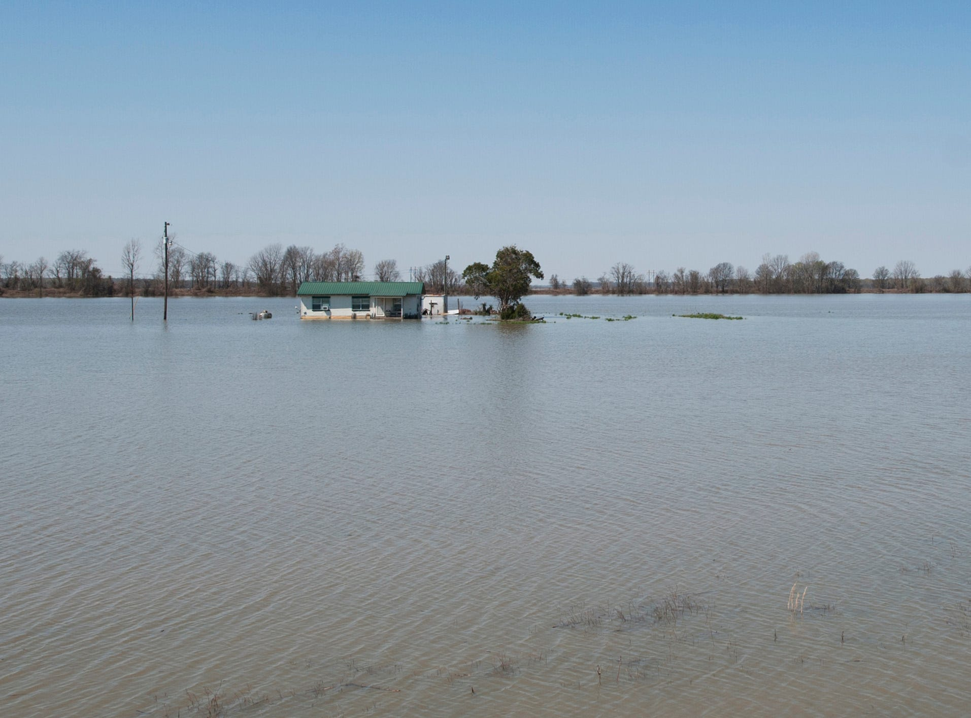 Just north of Valley Park in Issaquena County sits a lone house in a flooded cotton field. With backwater flooding, the slow rise of the water gives residents time to get out, but the disaster still comes.