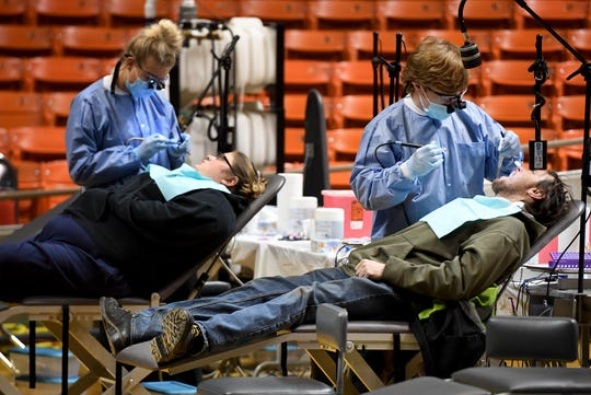 Dentists, hygienists, and dental assistants volunteered for the West Tennessee Mission of Mercy dental clinic, Friday, March 22.