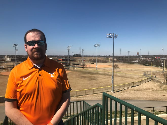 Jason Compton stands on a balcony of The Ballpark at Jackson, the Jackson Generals' home stadium, with the West Tennessee Healthcare Sportsplex in the background. Compton has announced his resignation as GM for the Generals to become the director of the Sportsplex.