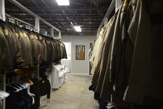 Uniforms hang in the basement of security firm Maxxguard's new building on the Highway 45 Bypass.