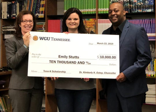 WGU Tennessee Chancellor Kimberly Estep is joined by Jackson-Madison County Schools Superintendent Eric Jones as they present teacher Emily Stutts with a check for $10,000.