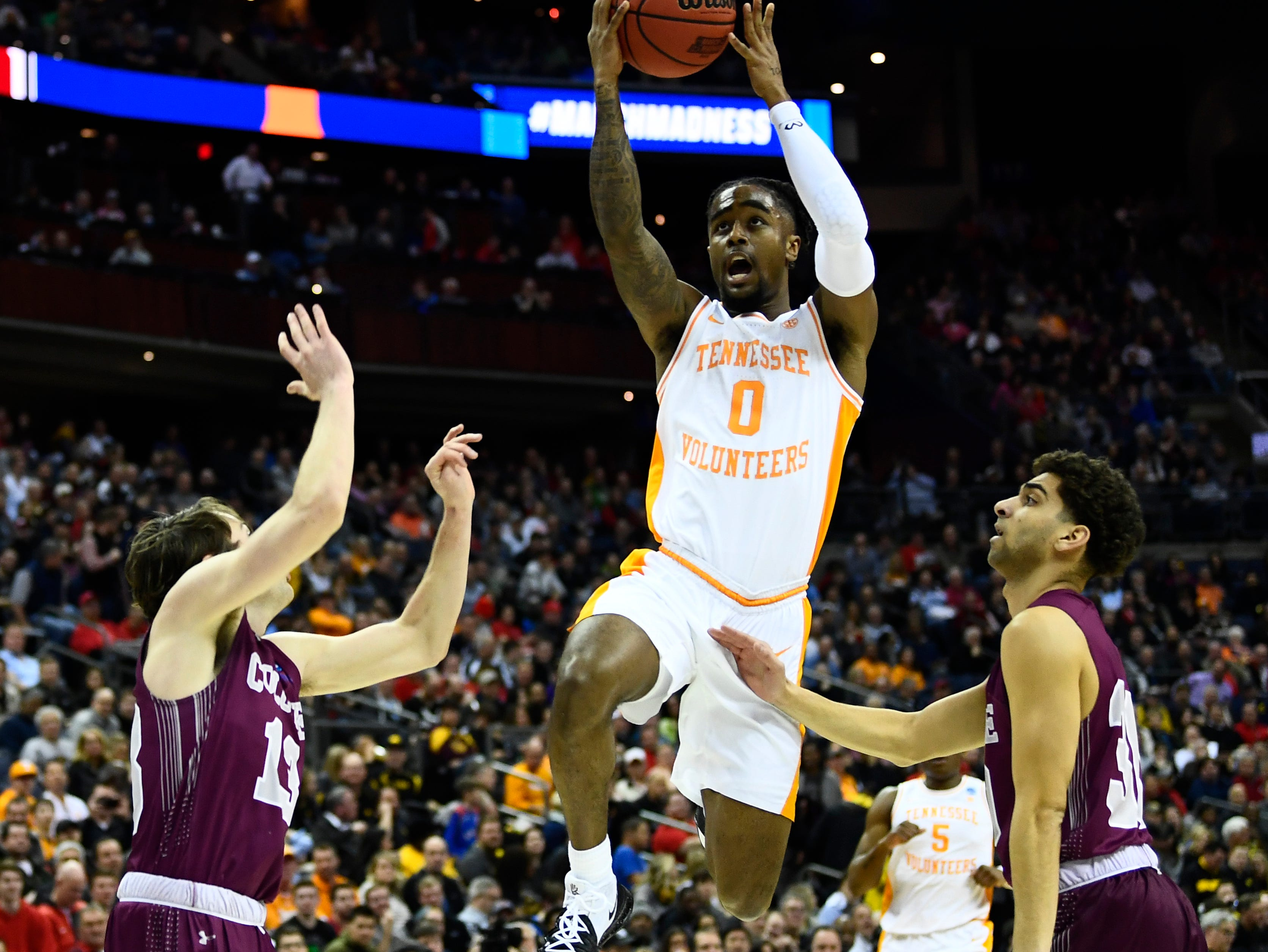 Tennessee guard Jordan Bone (0) shoots over Colgate guard Jack Ferguson (13) and Colgate guard Francisco Amiel (30) during the first round game of the NCAA Tournament at Nationwide Arena in Columbus, Ohio, on Friday, March 22, 2019.