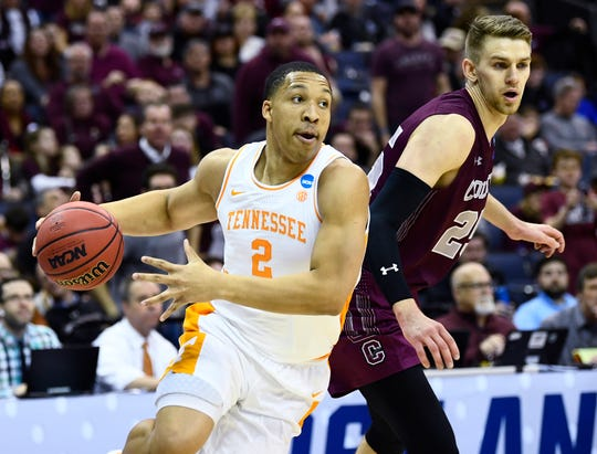 Tennessee forward Grant Williams (2) moves the ball defended by Colgate forward Rapolas Ivanauskas (25) during the first round game of the NCAA Tournament at Nationwide Arena in Columbus, Ohio, on Friday, March 22, 2019.