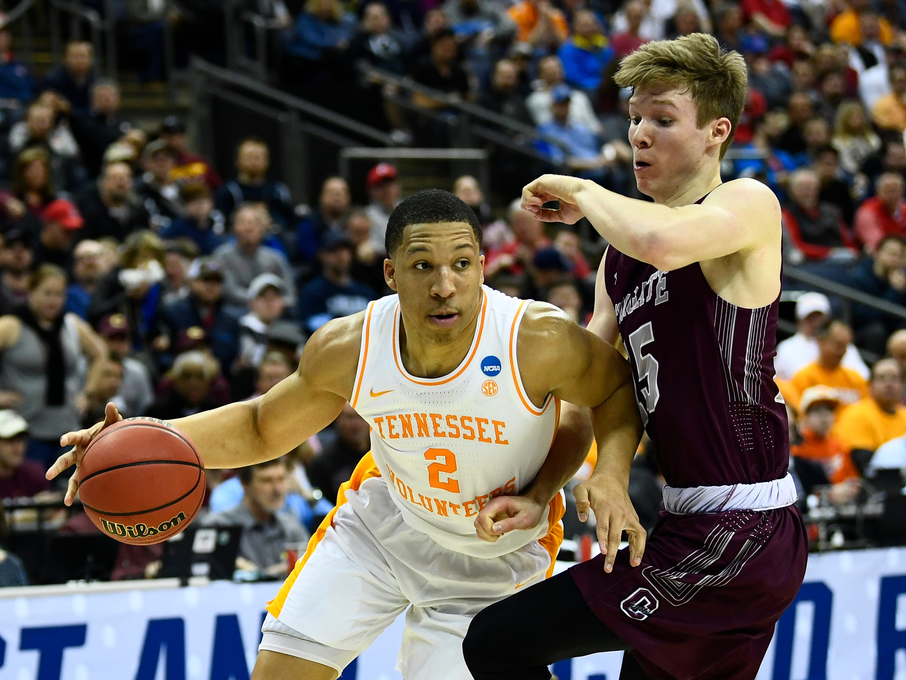 Tennessee forward Grant Williams (2) drives past Colgate guard Tucker Richardson (15) during the first round game of the NCAA Tournament at Nationwide Arena in Columbus, Ohio, on Friday, March 22, 2019.