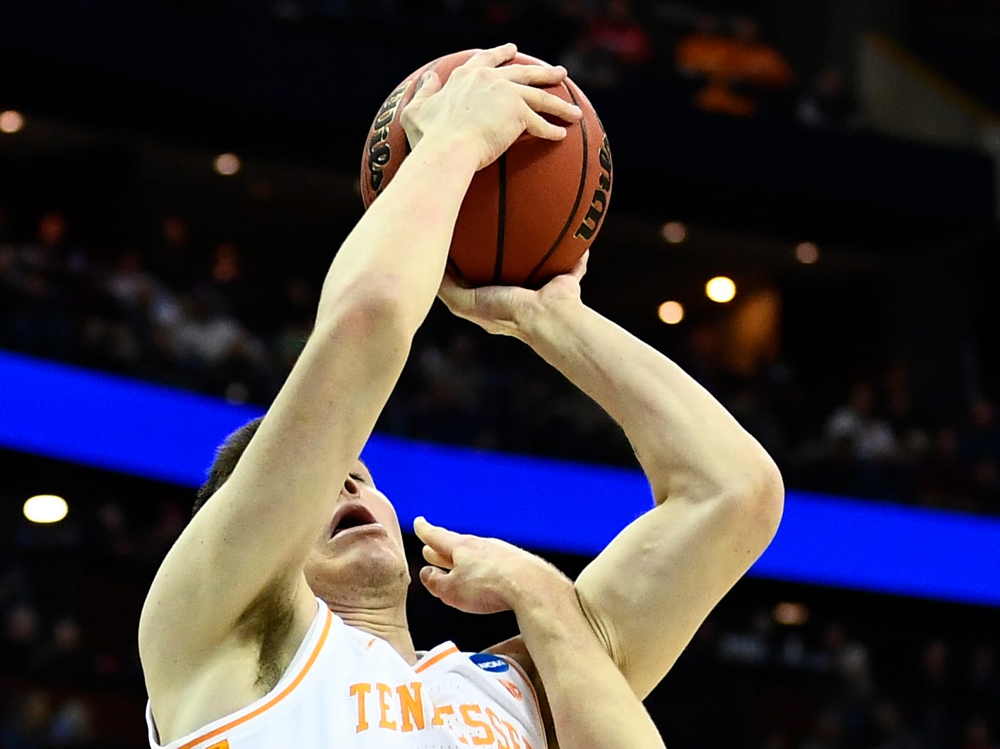 Tennessee forward John Fulkerson (10) goes for a layup against Colgate guard Tucker Richardson (15) during the first round of the NCAA Tournament at Nationwide Arena in Columbus, Ohio, on Friday, March 22, 2019.