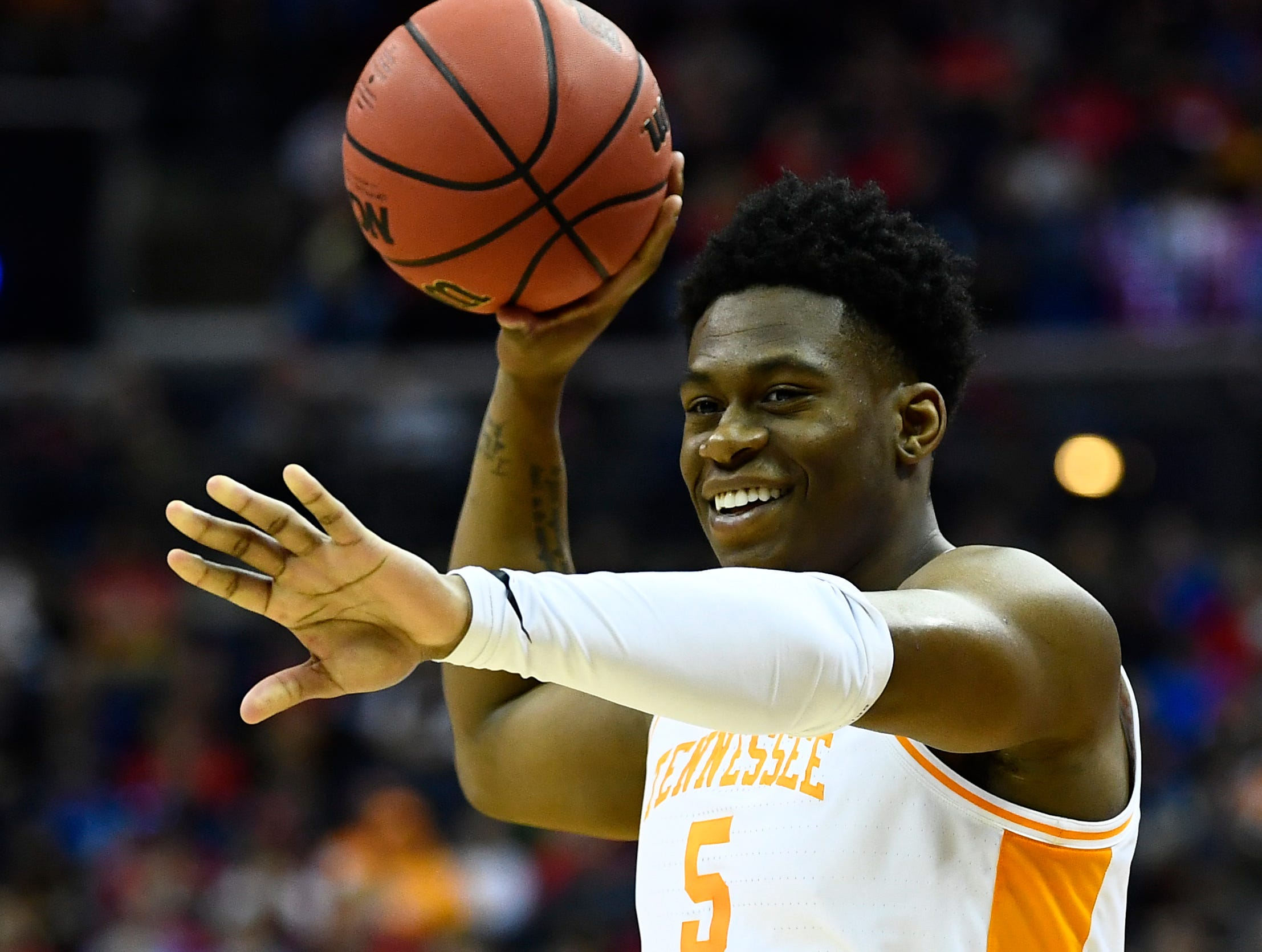 Tennessee guard Admiral Schofield (5) reaches to high-five a teammate during the game against the Colgate Raiders in the first round of the NCAA Tournament at Nationwide Arena in Columbus, Ohio, on Friday, March 22, 2019.