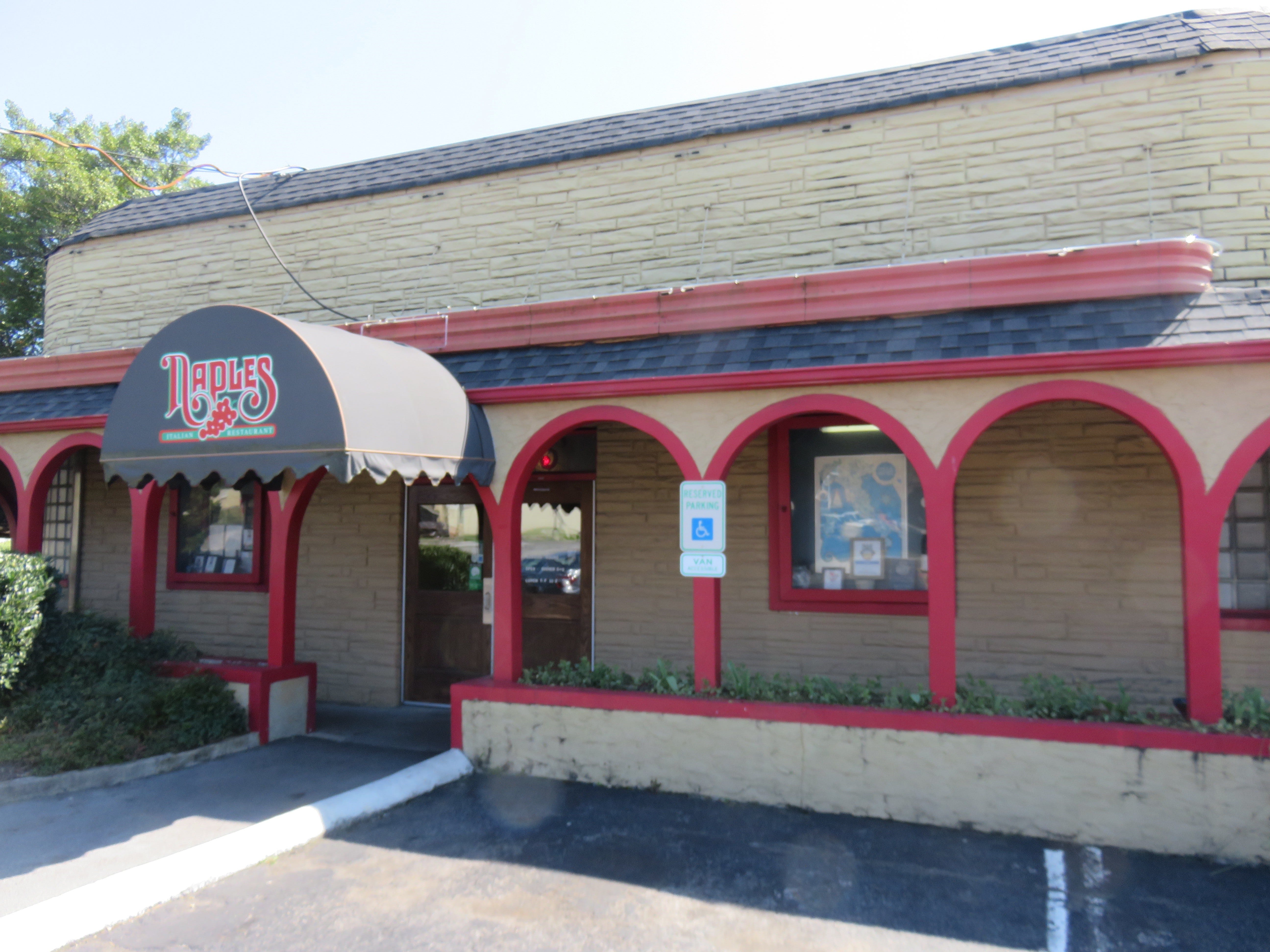 The front of Naples Italian Restaurant is shown on March 20. The restaurant property has been sold by longtime owners Bob and Becky Luper. 2019