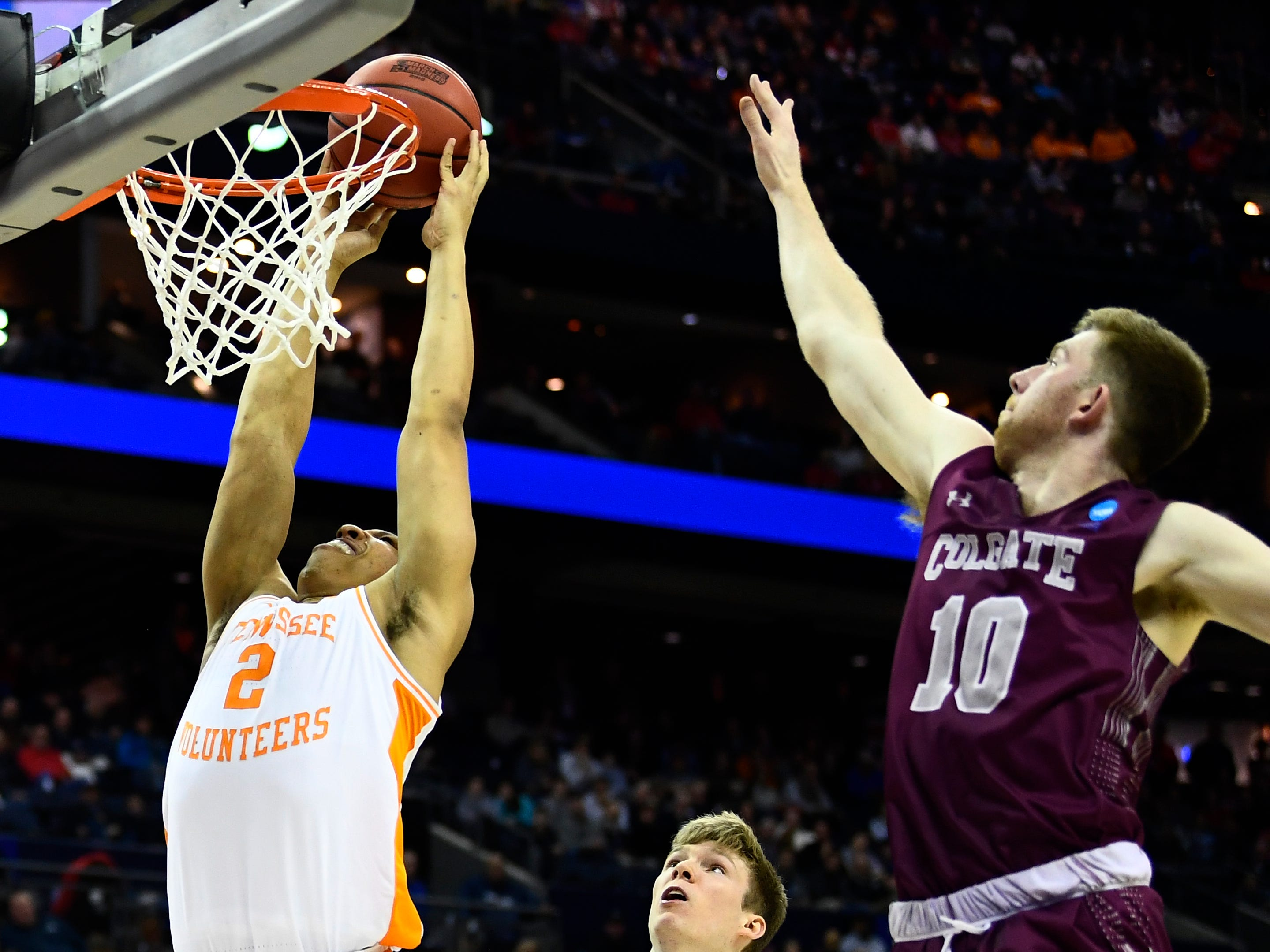 Tennessee forward Grant Williams (2) attempts a dunk defended by Colgate forward Will Rayman (10) during their first round game in the NCAA Tournament at Nationwide Arena in Columbus, Ohio, on Friday, March 22, 2019.