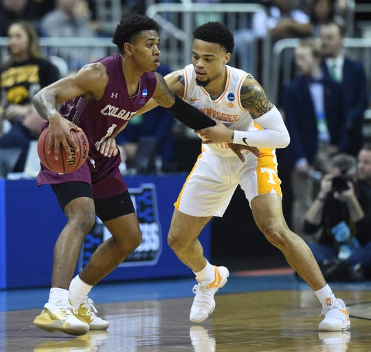 Tennessee guard Lamonte Turner (1) defends Colgate guard Jordan Burns (1) during their first round game in the NCAA Tournament at Nationwide Arena in Columbus, Ohio, on Friday, March 22, 2019.