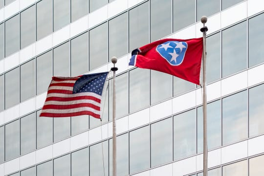 Adopted in 1905, Tennessee's state flag features three stars representing the grand divisions of the state: East, Middle and West.