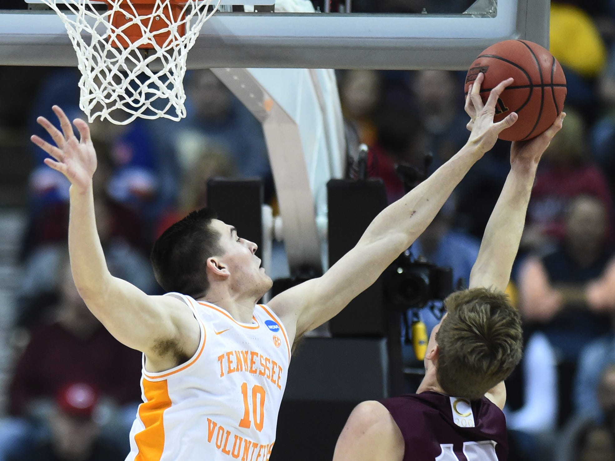 Tennessee forward John Fulkerson (10) defends against Colgate guard Tucker Richardson (15) during their first round game of the NCAA Tournament at Nationwide Arena in Columbus, Ohio, on Friday, March 22, 2019.