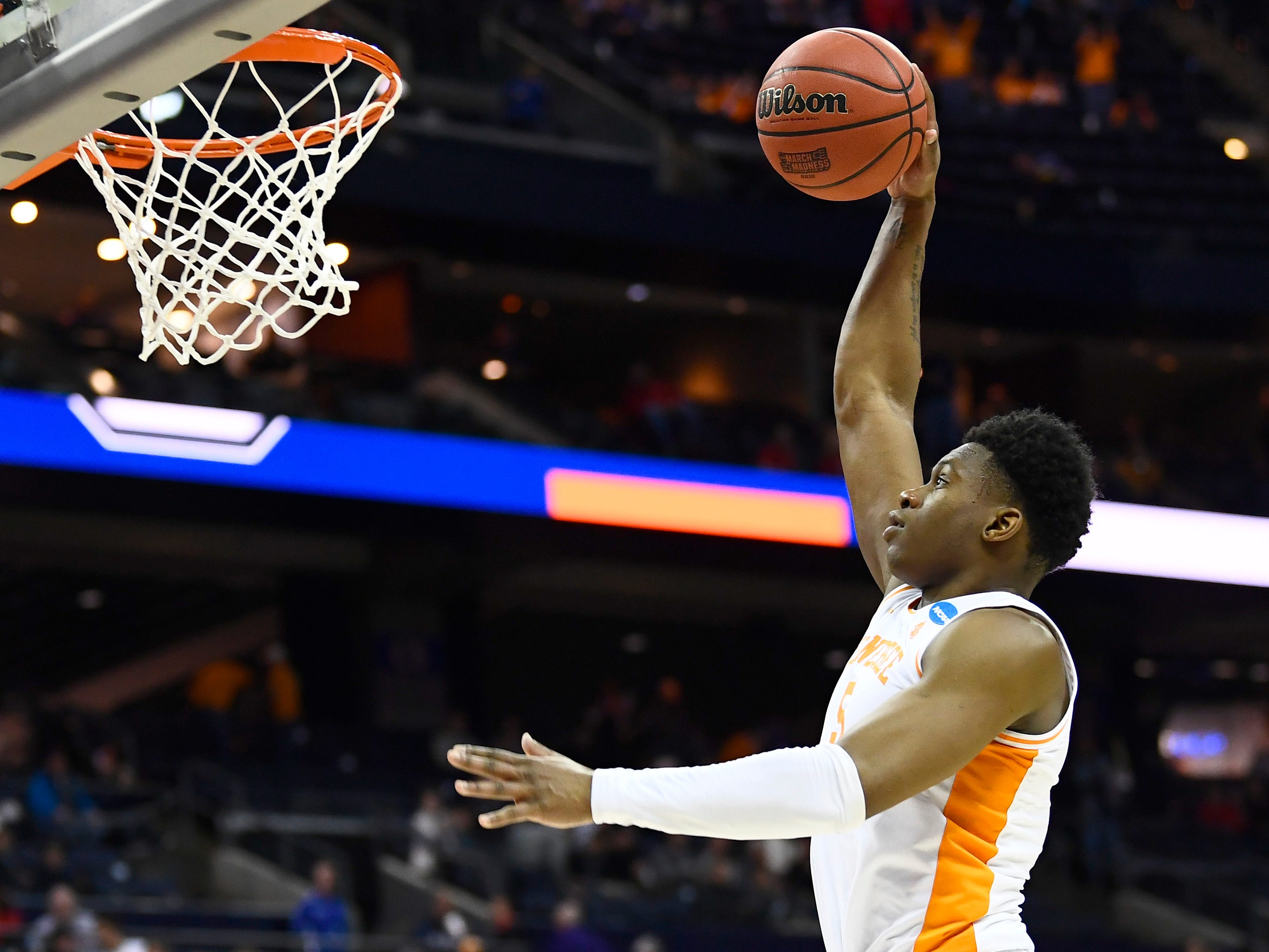 Tennessee guard Admiral Schofield (5) goes in for a dunk against Colgate in the first round of the NCAA Tournament at Nationwide Arena in Columbus, Ohio, on Friday, March 22, 2019.