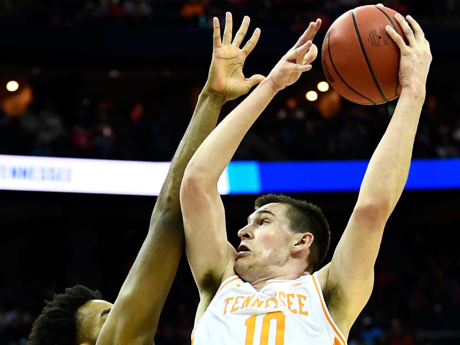 Tennessee forward John Fulkerson (10) shoots against Colgate forward Malcolm Regisford (5) during their first round game of the NCAA Tournament at Nationwide Arena in Columbus, Ohio, on Friday, March 22, 2019.