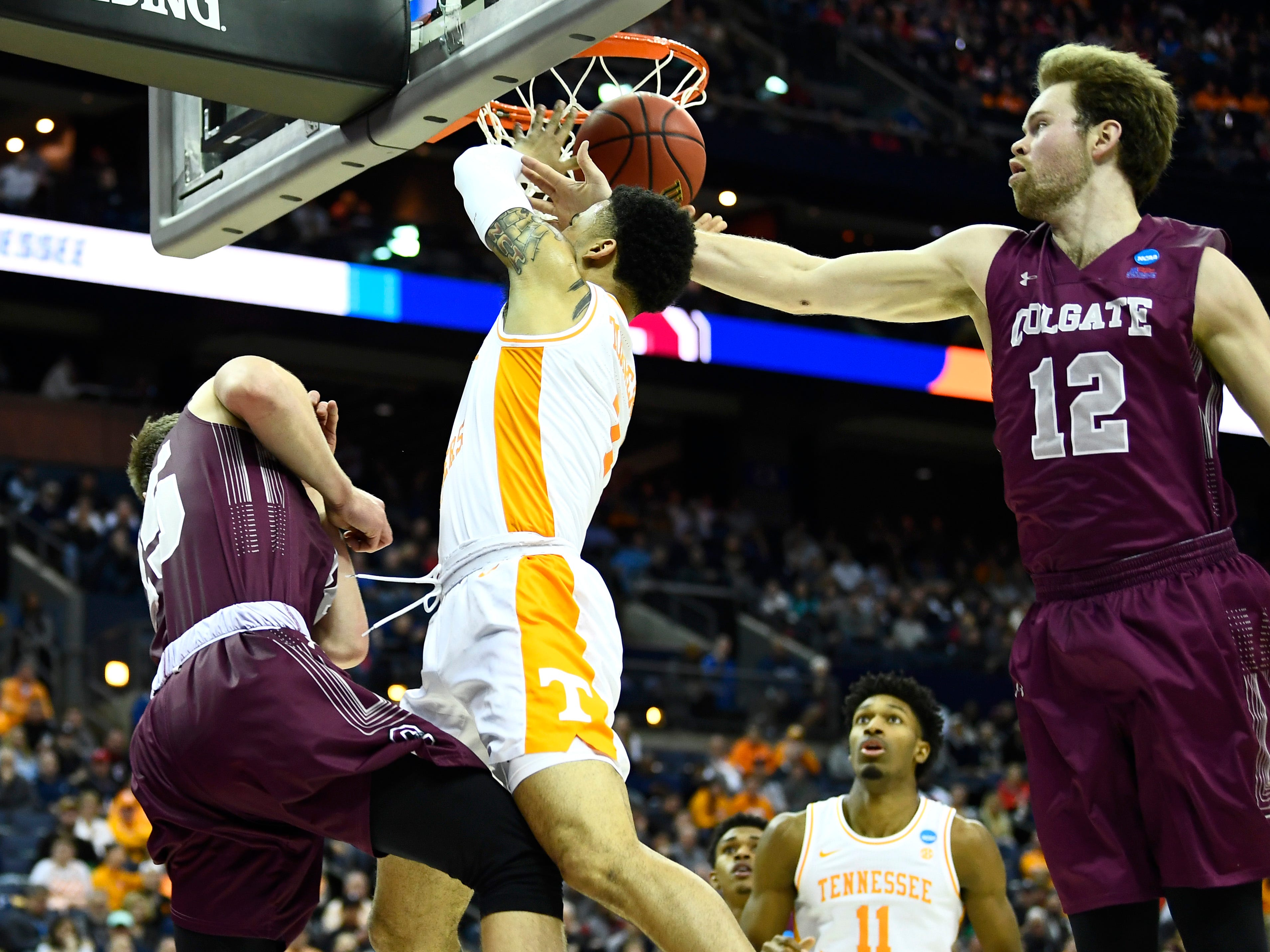 Tennessee guard Lamonte Turner (1) is fouled by Colgate center Dana Batt (12) during their first round game of the NCAA Tournament at Nationwide Arena in Columbus, Ohio, on Friday, March 22, 2019.