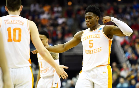 Tennessee guard Admiral Schofield (5) high fives forward John Fulkerson (10) after a foul against Colgate during the first round game of the NCAA Tournament at Nationwide Arena in Columbus, Ohio, on Friday, March 22, 2019.