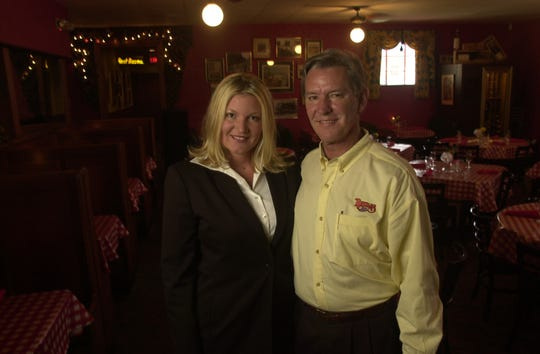 Naples restaurant owner Bob Luper and his daughter, Christi Norton, in 2003. Christi at the time was assistant manager and her brother, Jay, was a cook. Paul Efird/News Sentinel